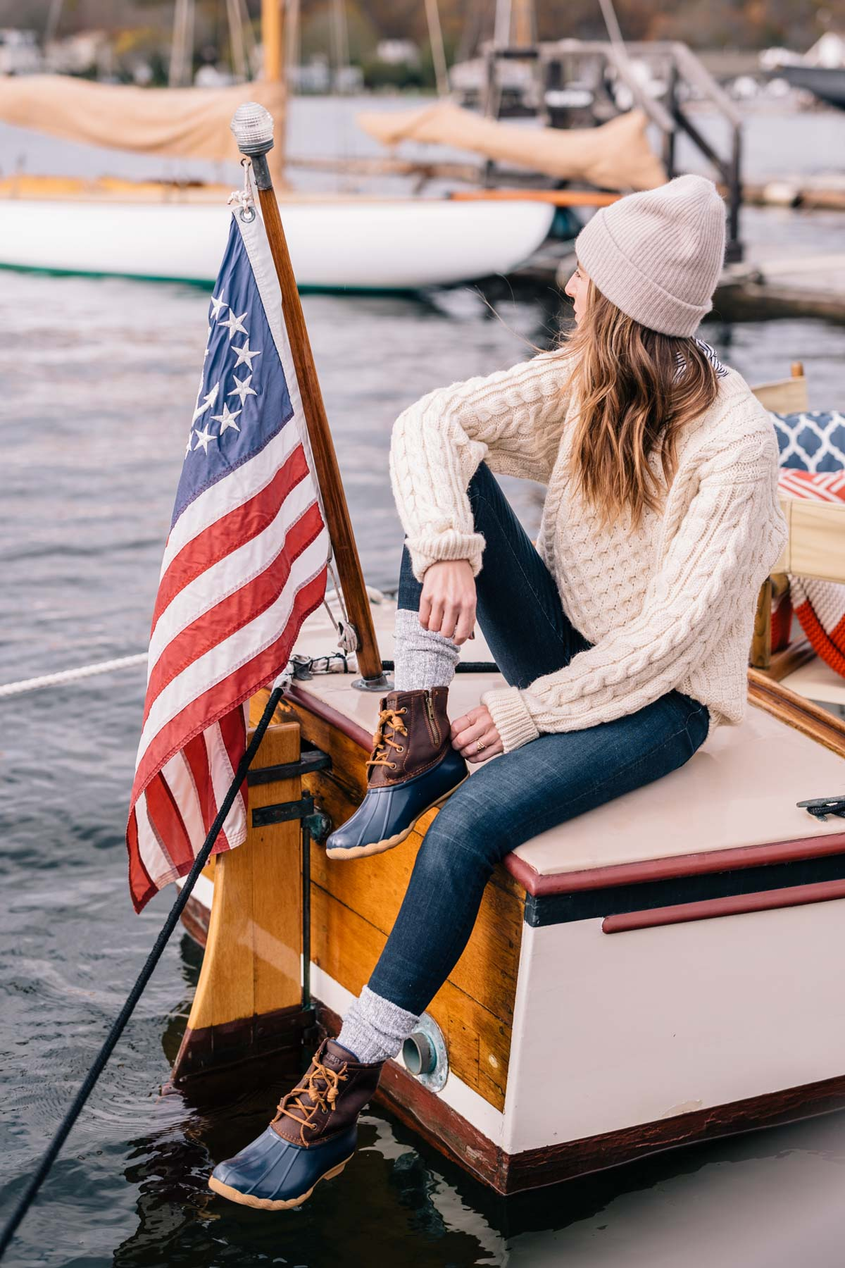 Jess Ann Kirby wears sperry duck boots and a LL Bean fisherman sweater to weather New England in the fall