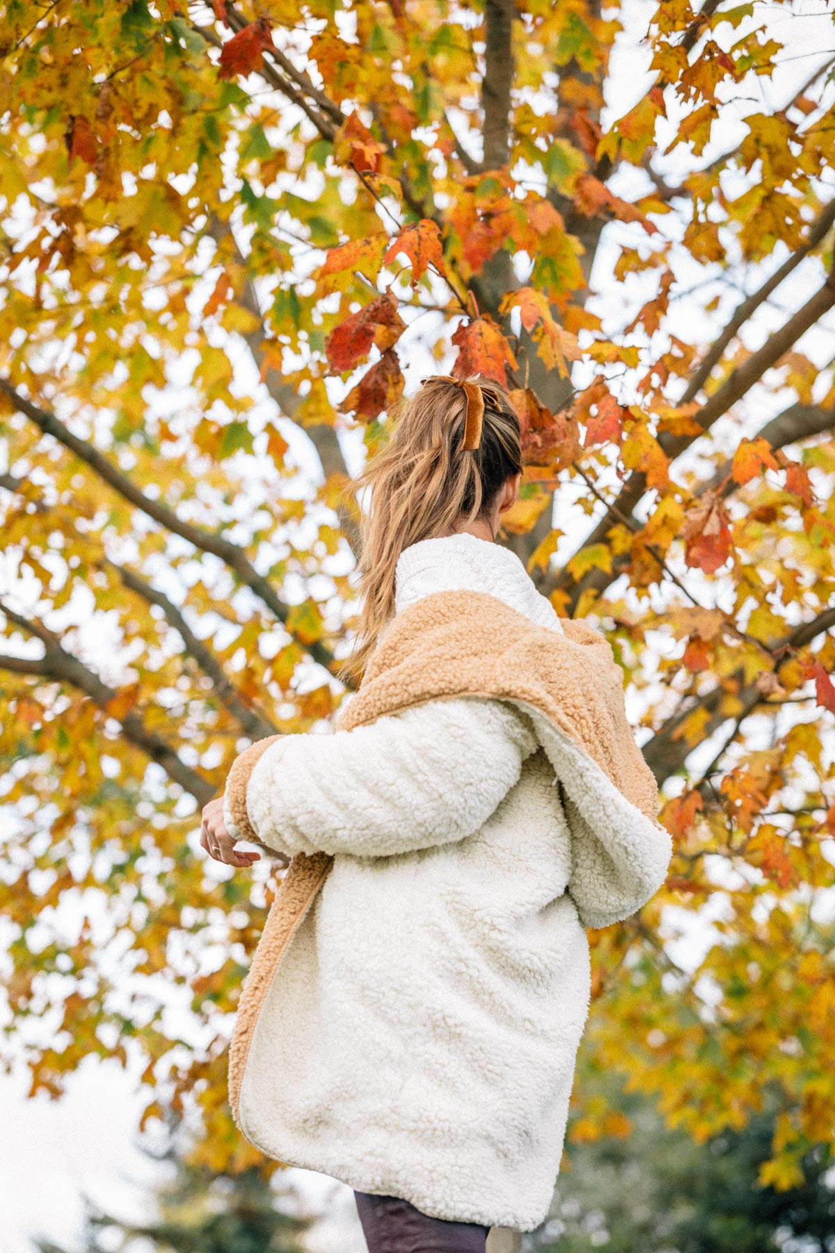 Jess Ann Kirby styles a fall look featuring the Urban Outfitters Magnolia Cozy Reversible Coat