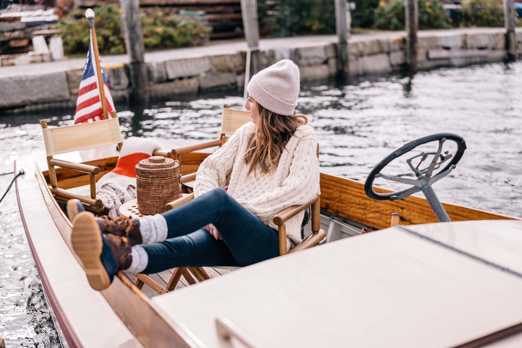 Jess Ann Kirby wears speedy boots and a LL Bean fisherman sweater to weather New England in the fall