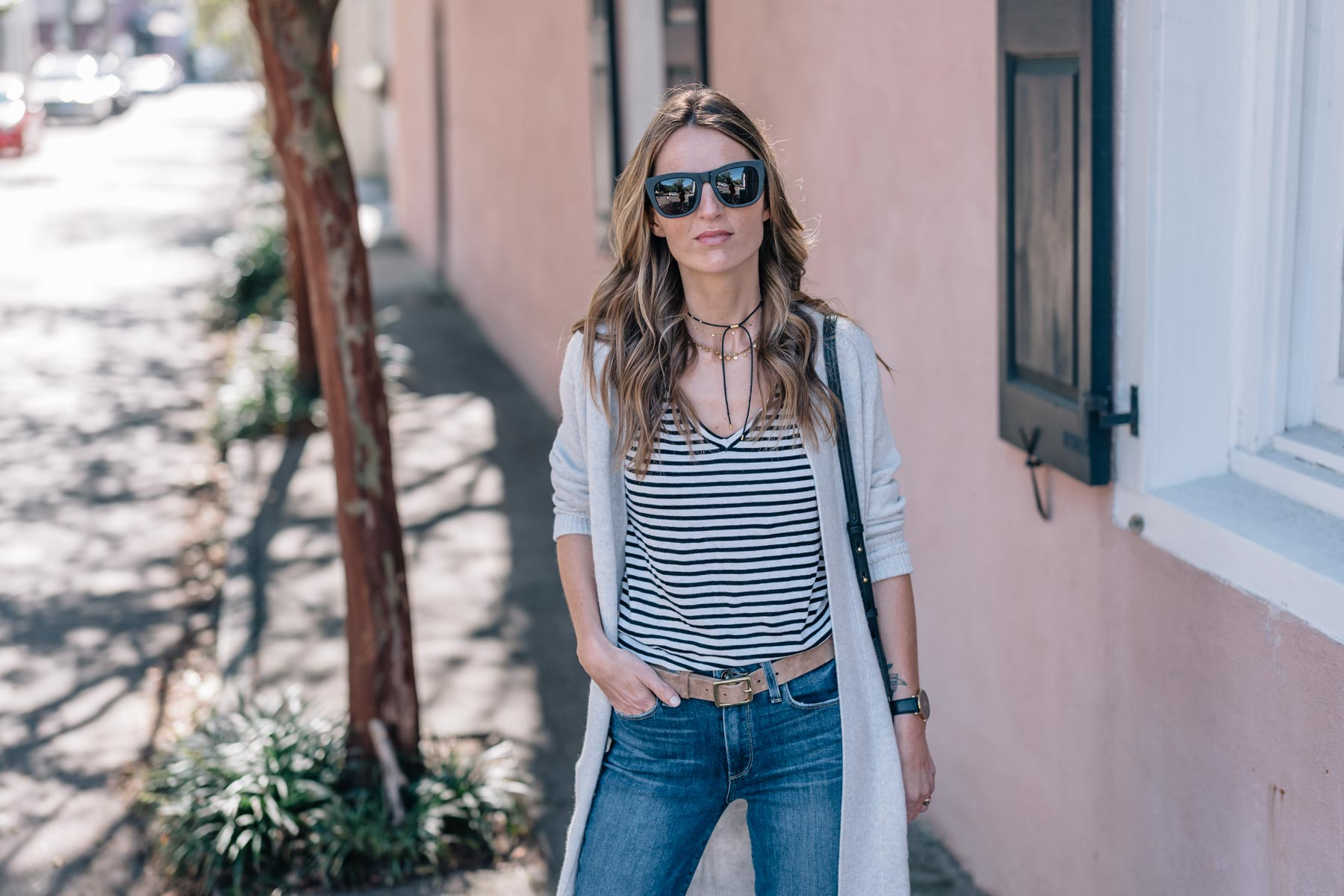 Jess Ann Kirby styles a cashmere cardigan with a stripe tee, madewell necklace, paige skinny jeans and dolce vita ankle boots for fall