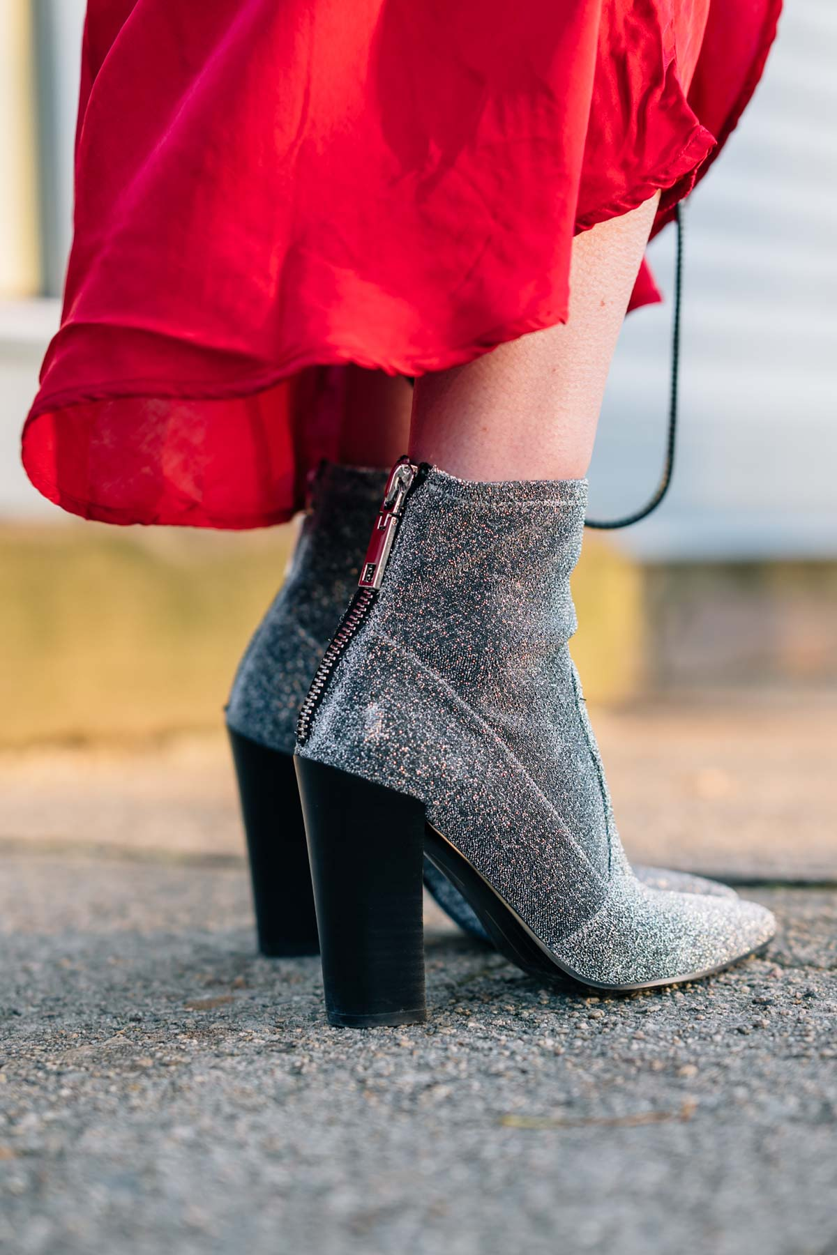 Jess Ann Kirby wears Dolce Vita elana stretch booties for a holiday look