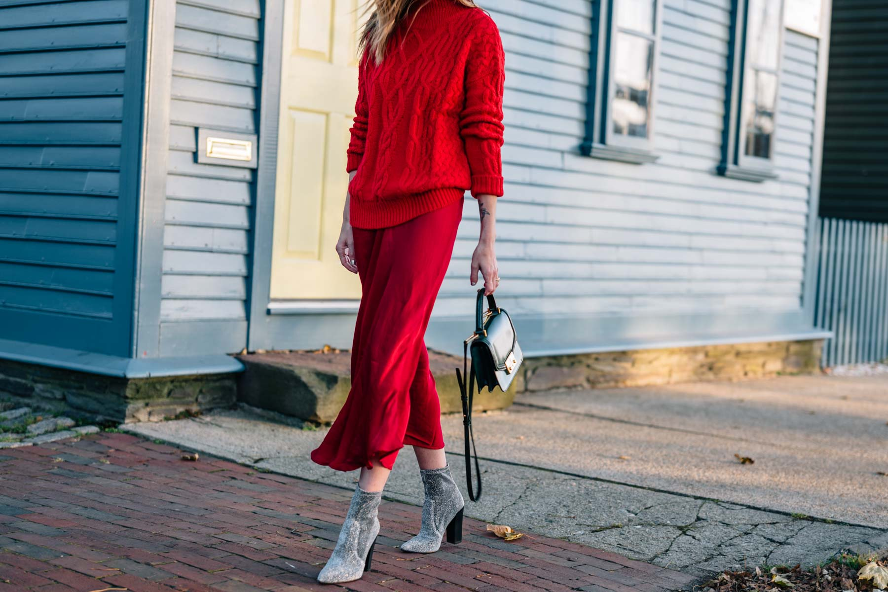 Jess Ann Kirby shares how to wear red on red this holiday season with sparkle ankle boots