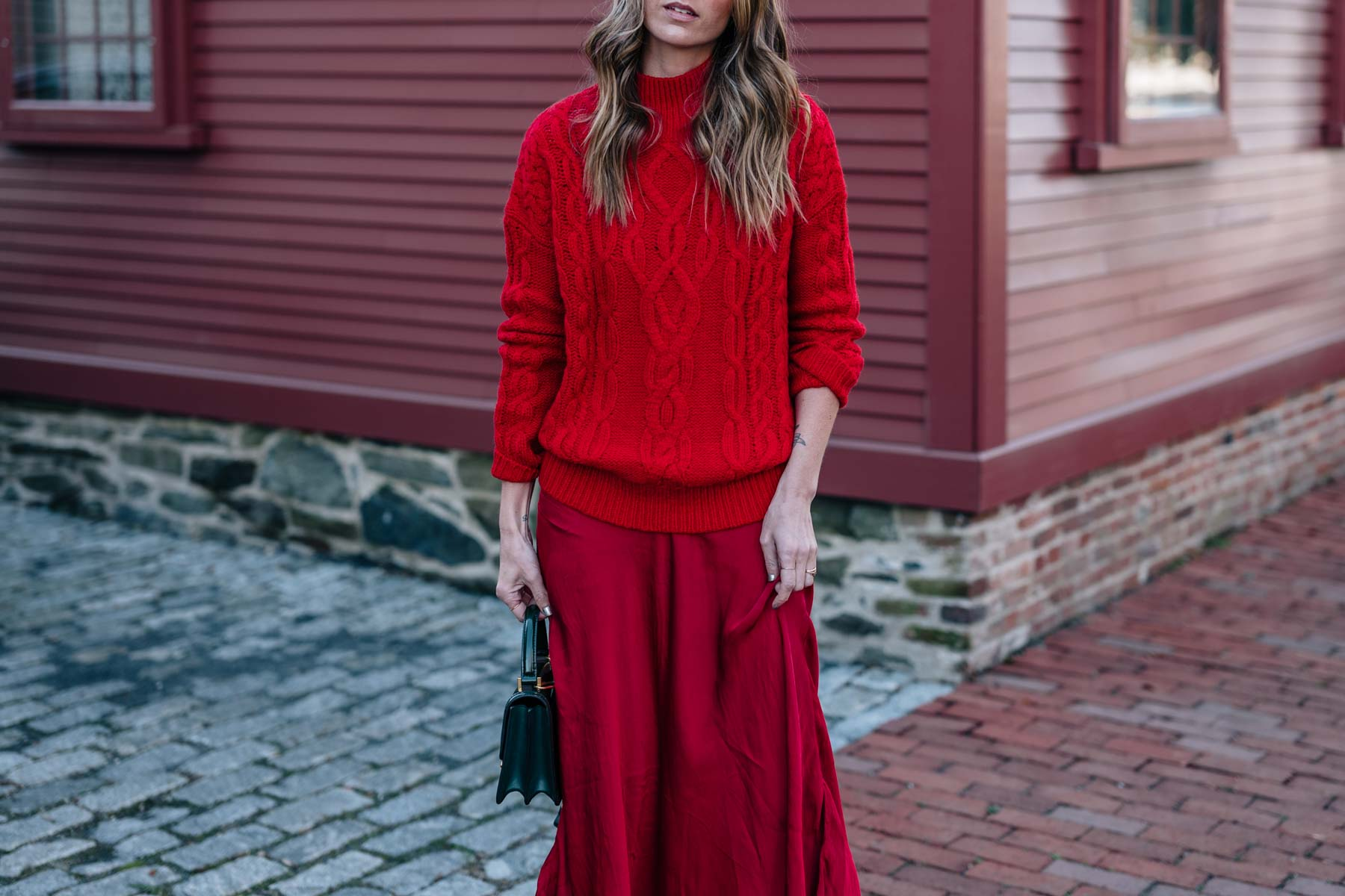Jess Ann Kirby shares how to wear red on red this holiday season with a cable knit sweater and sparkle ankle boots