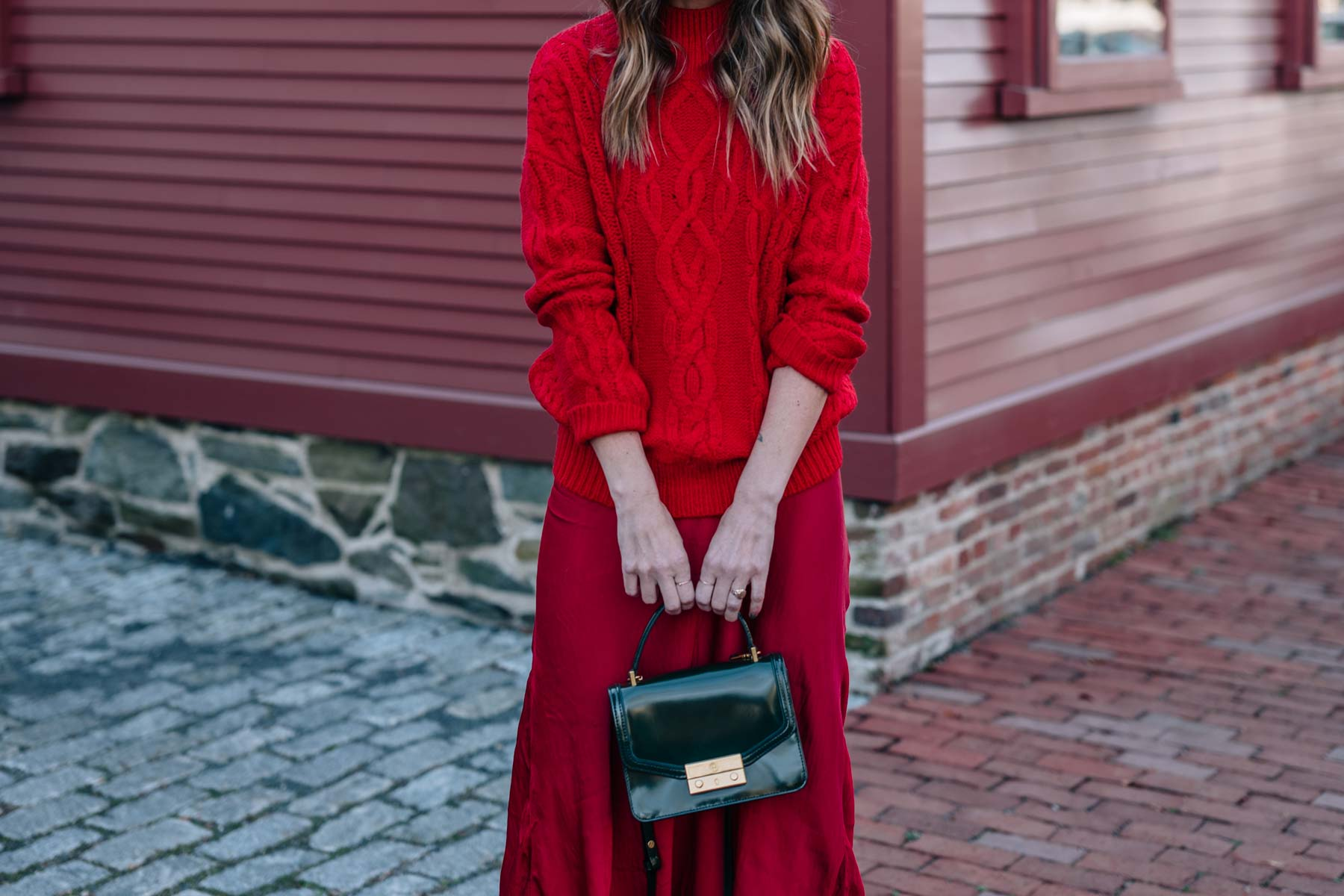 Jess Ann Kirby shares how to wear red on red this holiday season with sparkle ankle boots and the tory burch mini Juliette bag