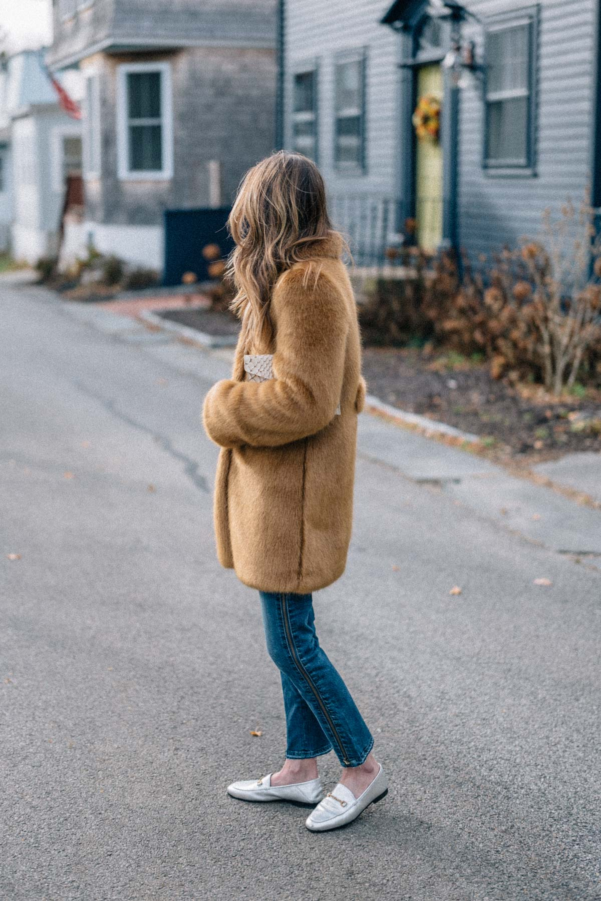 Jess Ann Kirby styles her custom Frilly faux fur jacket with Paige jeans and Sam Edelman loafers