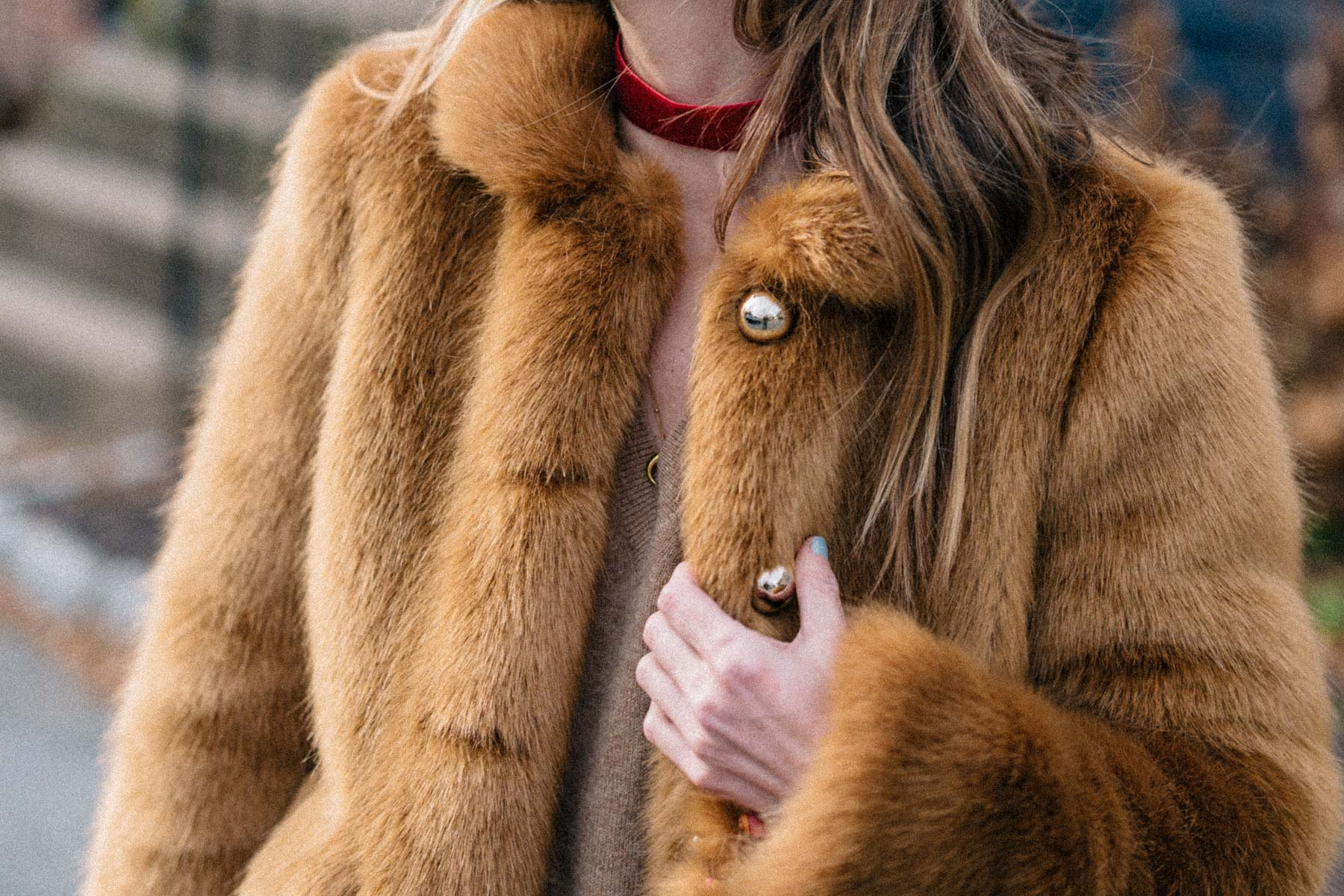 Jess Ann Kirby designed the perfect faux fur coat with Frilly and styles it with a cashmere sweater and velvet choker
