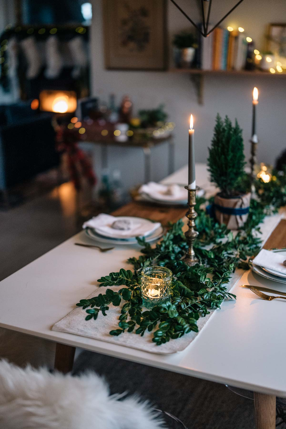 Jess Ann Kirby sets her dining table for the holidays with rustic and chic accents like gold decor and greenery