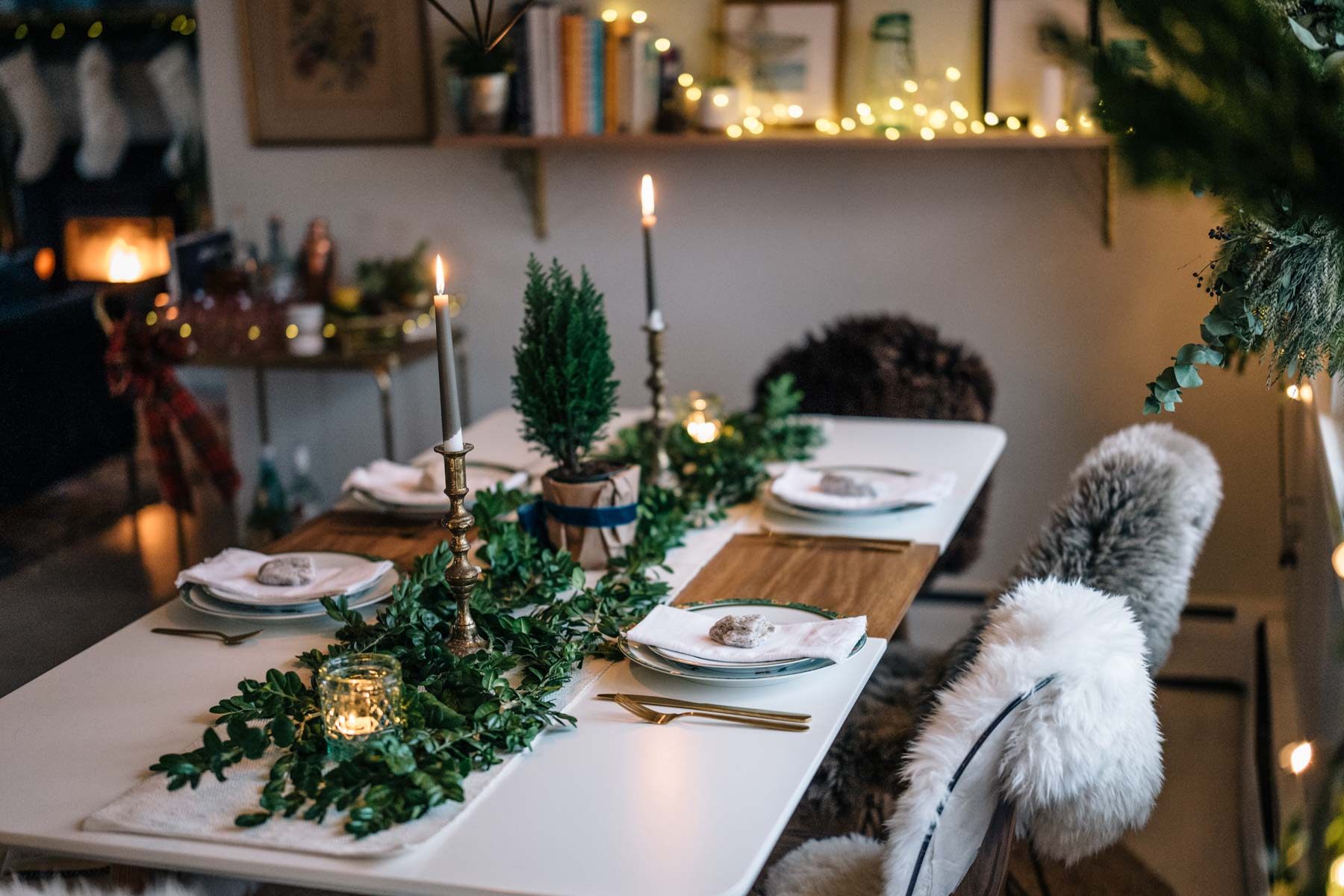 Jess Ann Kirby's holiday tablescape is rustic and chic with greenery and hints of gold