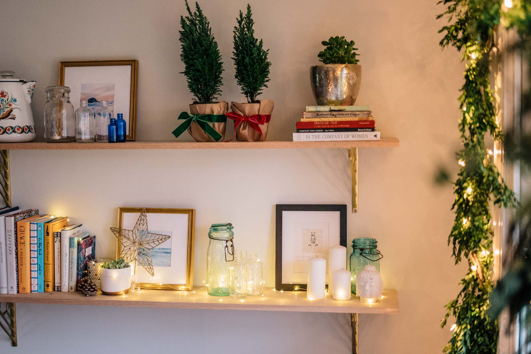 Jess Ann Kirby shares her holiday decor including twinkle lights and potted mini trees