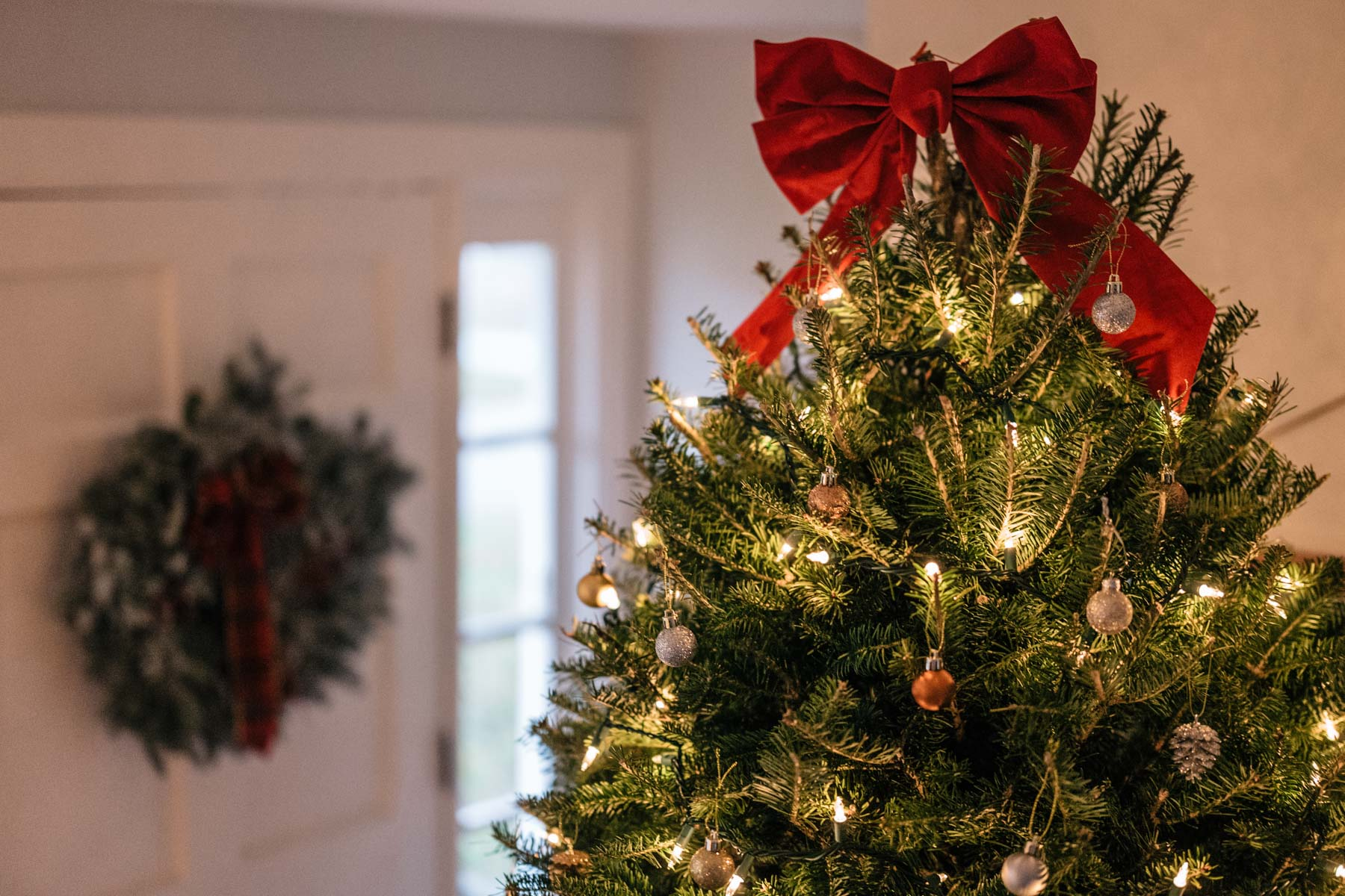 Jess Ann Kirby tops her Christmas tree this year with a big red bow