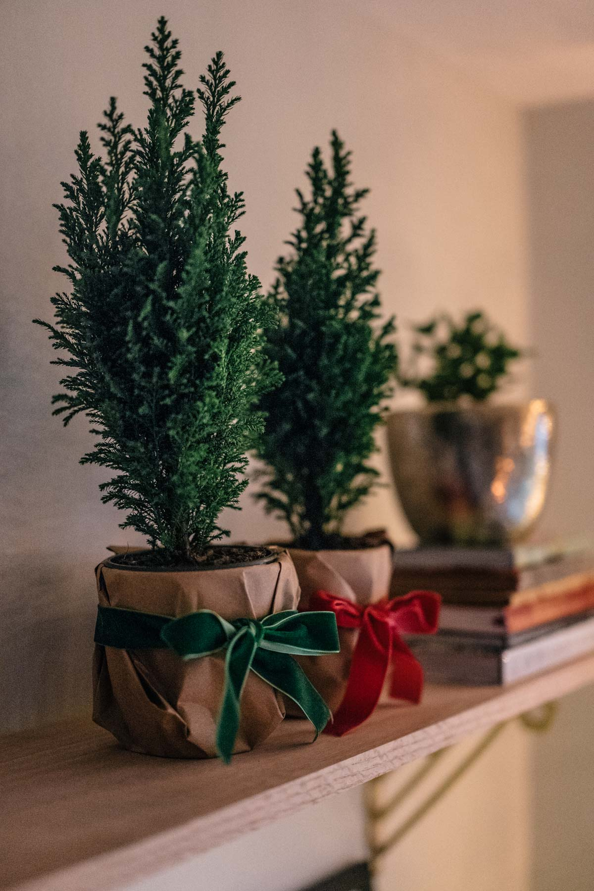 Jess Ann Kirby decorates her home this holiday season with DIY mini trees with velvet bows