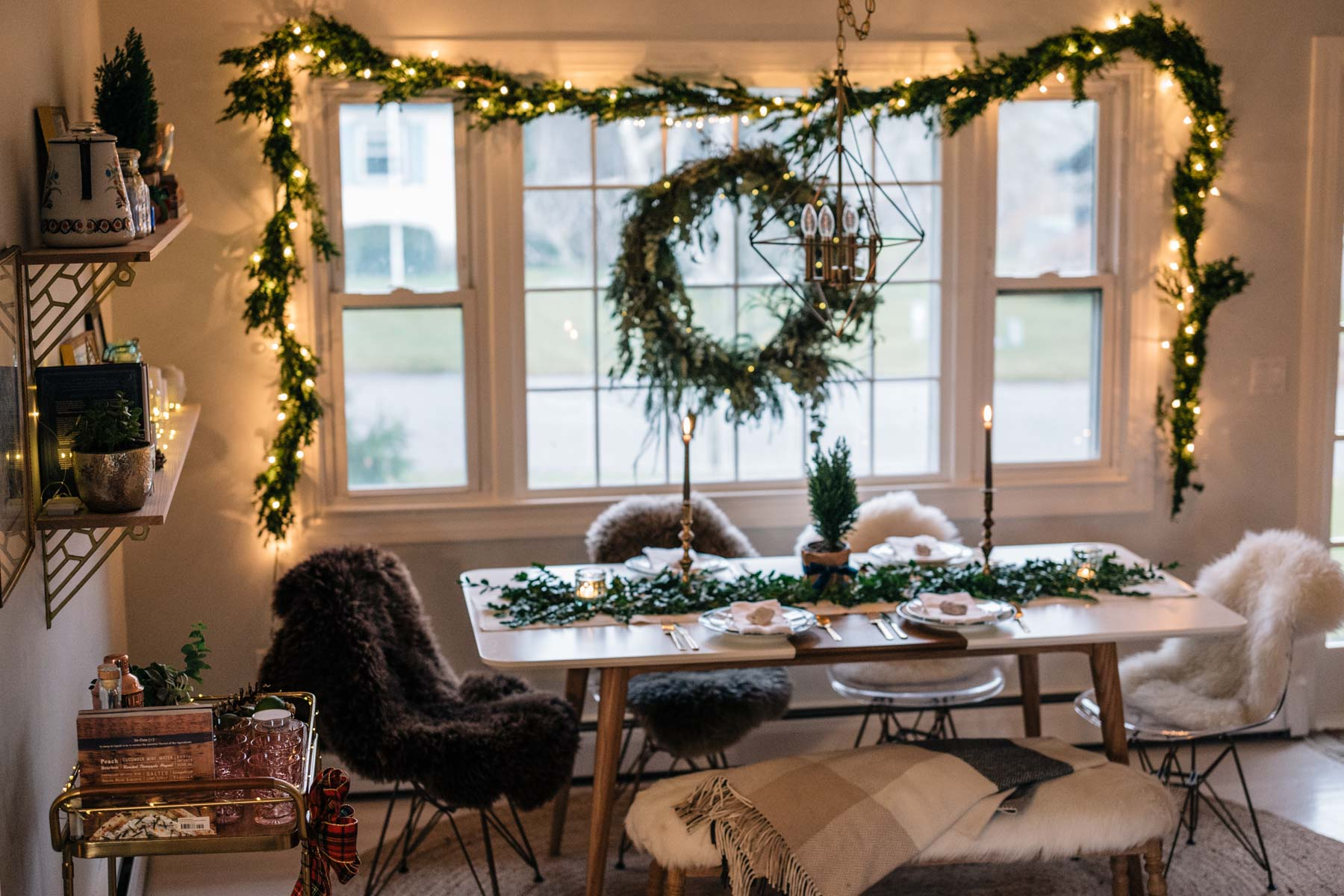 Jess Ann Kirby decorates her home for the holidays with simple items like garland and twinkle lights