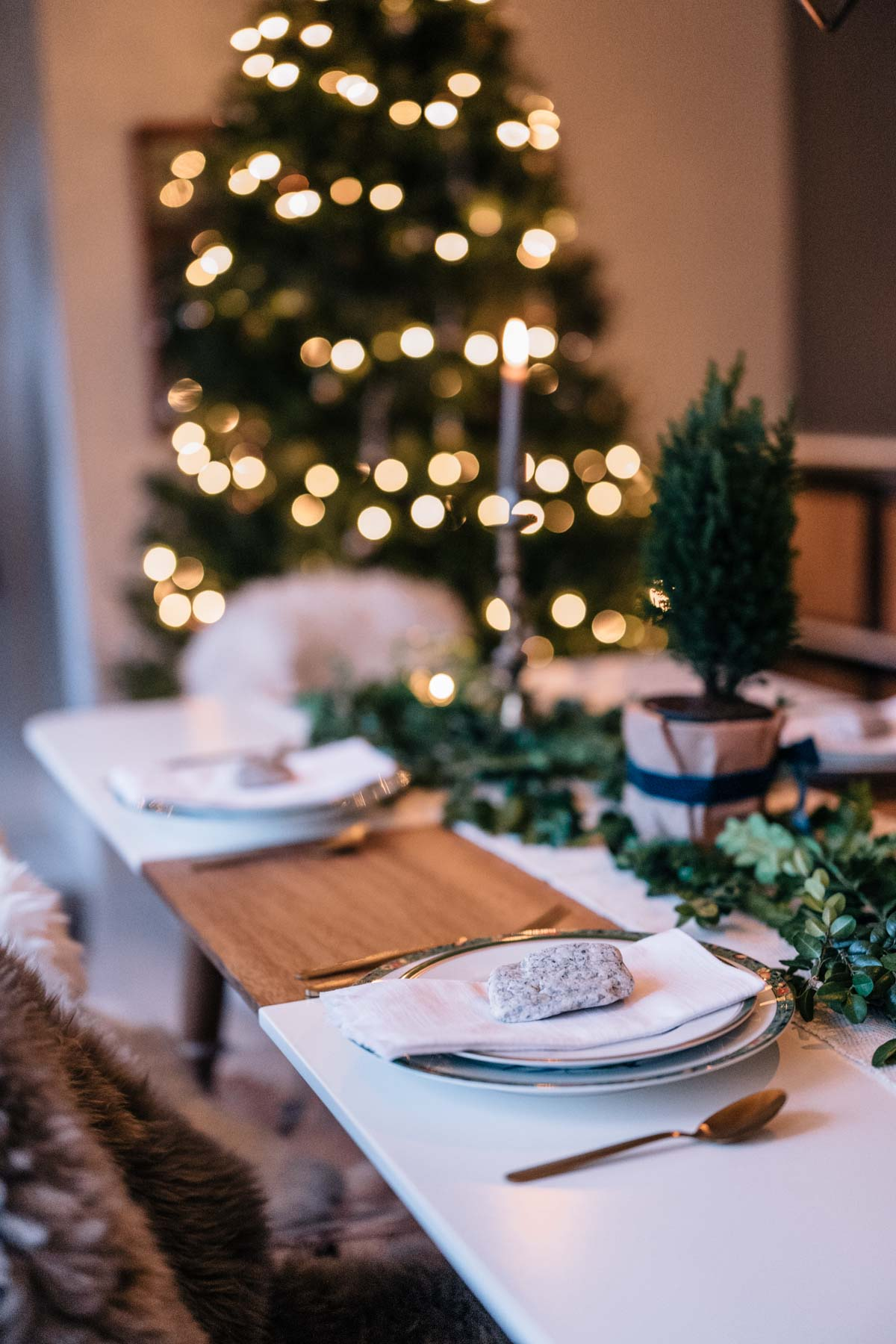 Jess Ann Kirby's home is decorated for the holidays with a rustic tablescape and large tree