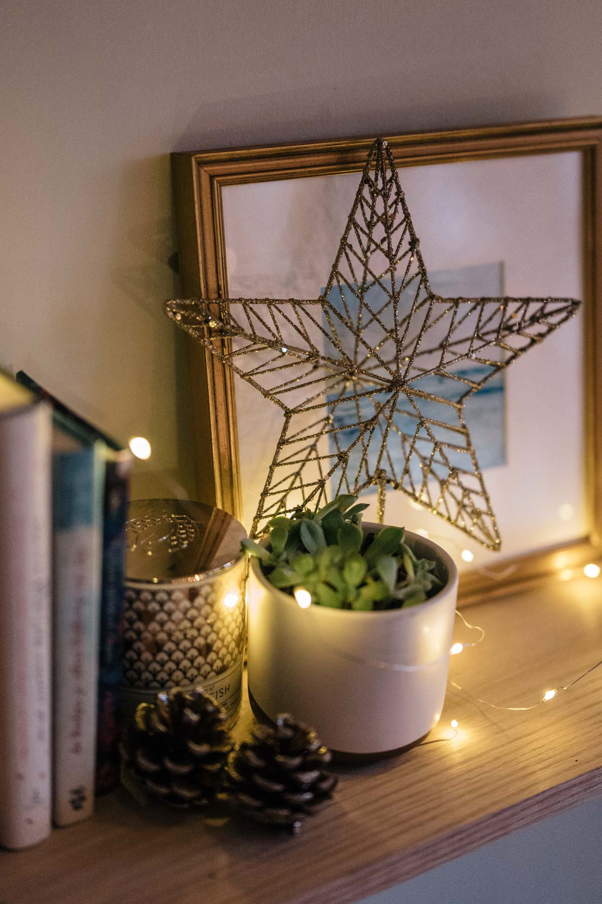 Jess Ann Kirby decorates her home for the holidays with easy DIY decor such as a tree topper with pine cones