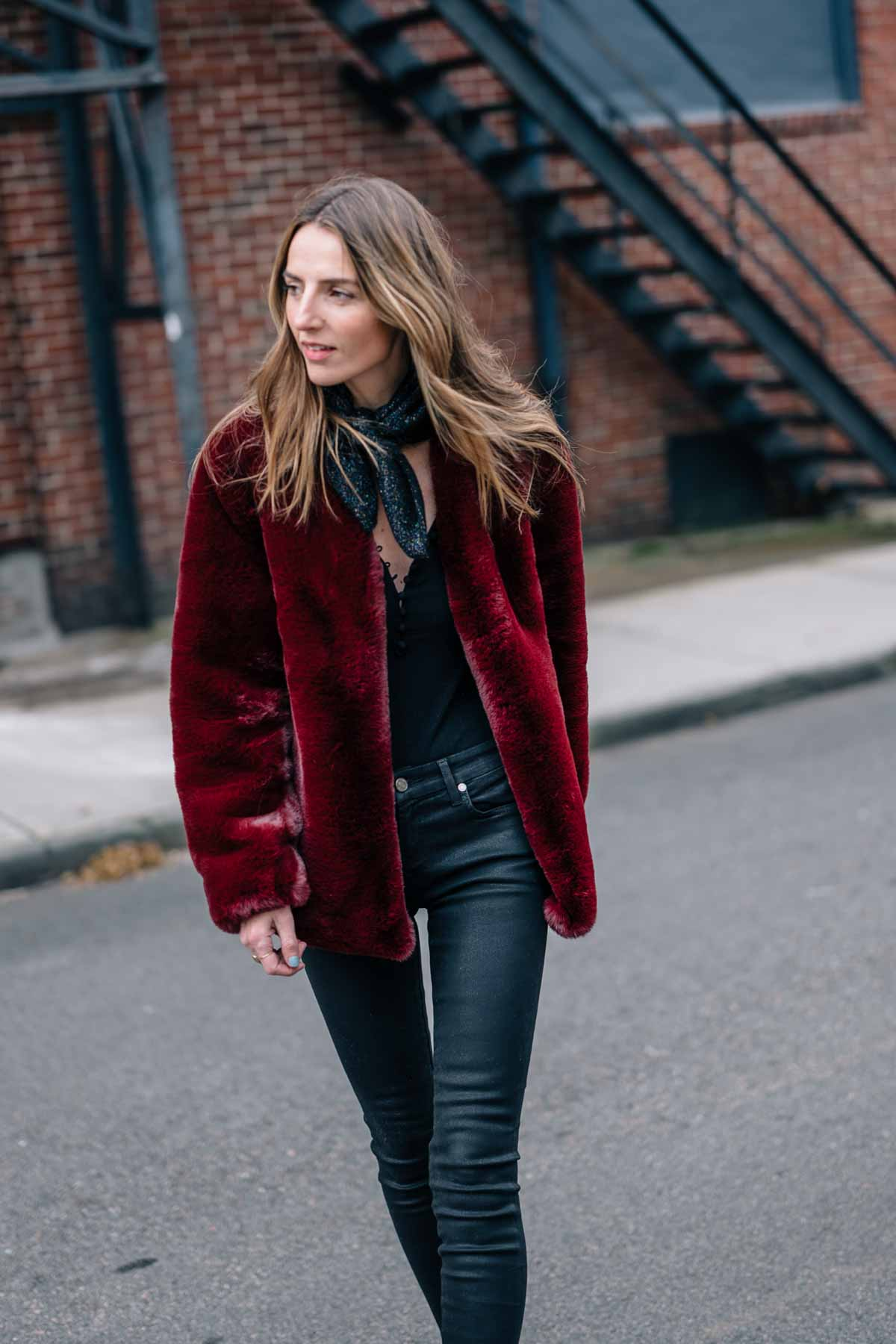 Jess Ann Kirbey styles a burgundy faux fur jacket with 7 for all man kind coated skinny jeans from Shop Bop in Newport, Rhode Island
