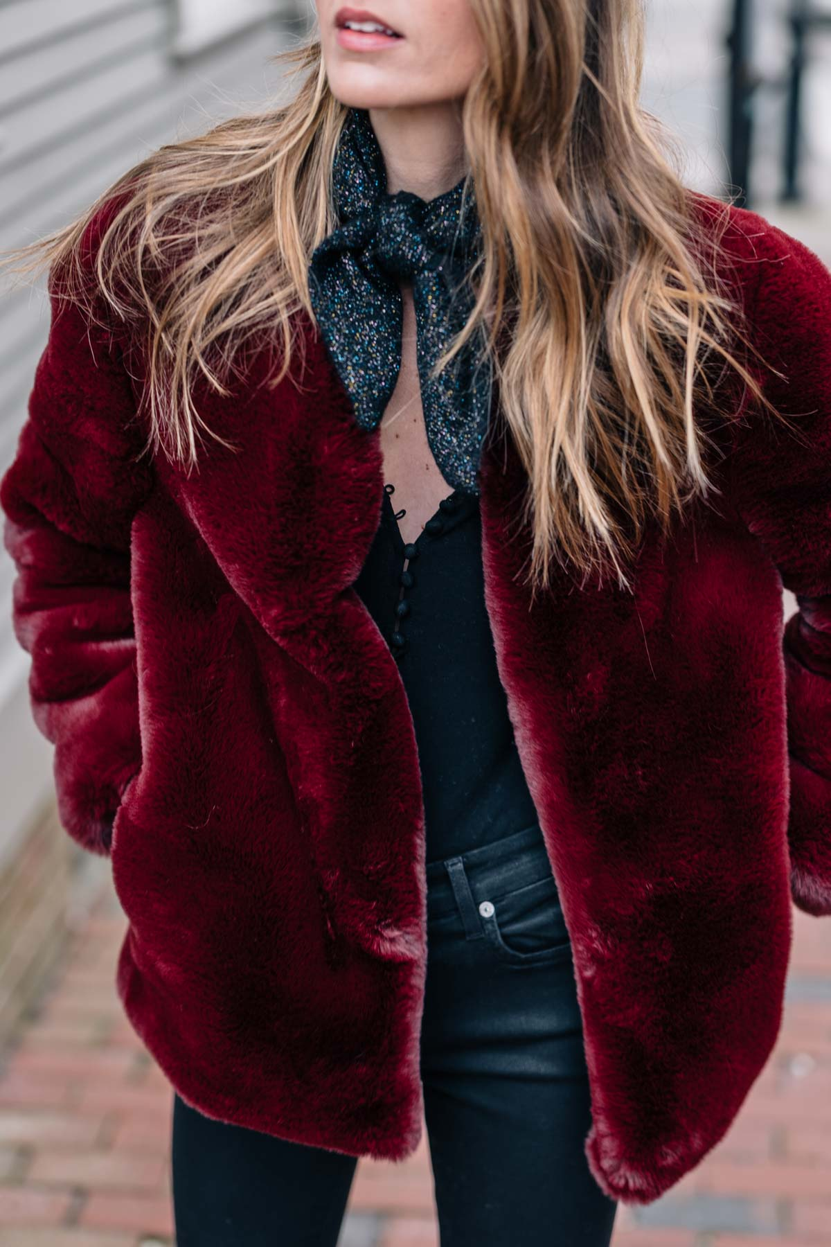Jess Ann Kirby shares her holiday style this season in a burgundy Moon River faux fur jacket and Warren sparkle cashmere scarf