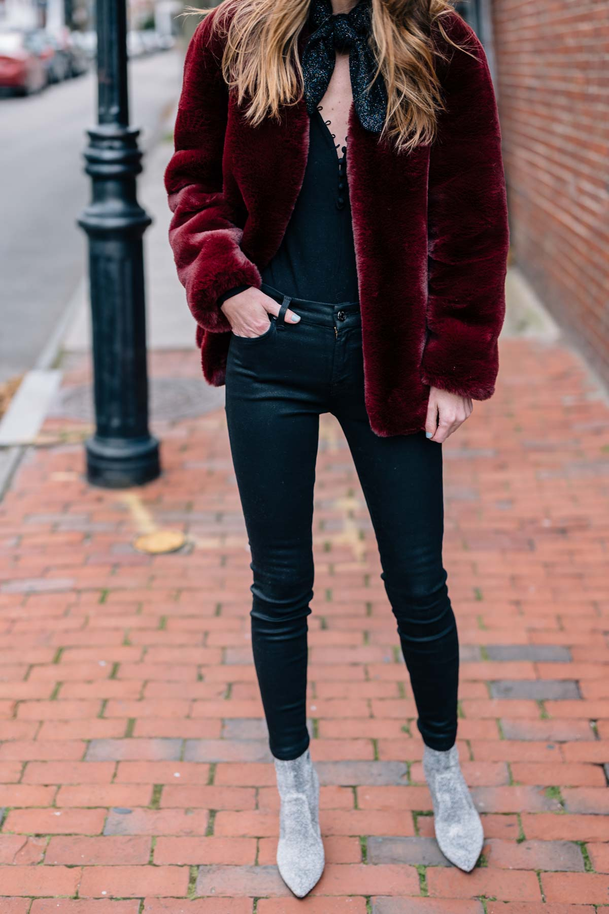 Jess Ann Kirby shares her holiday style this season in a burgundy Moon River faux fur jacket and sparkle cashmere scarf