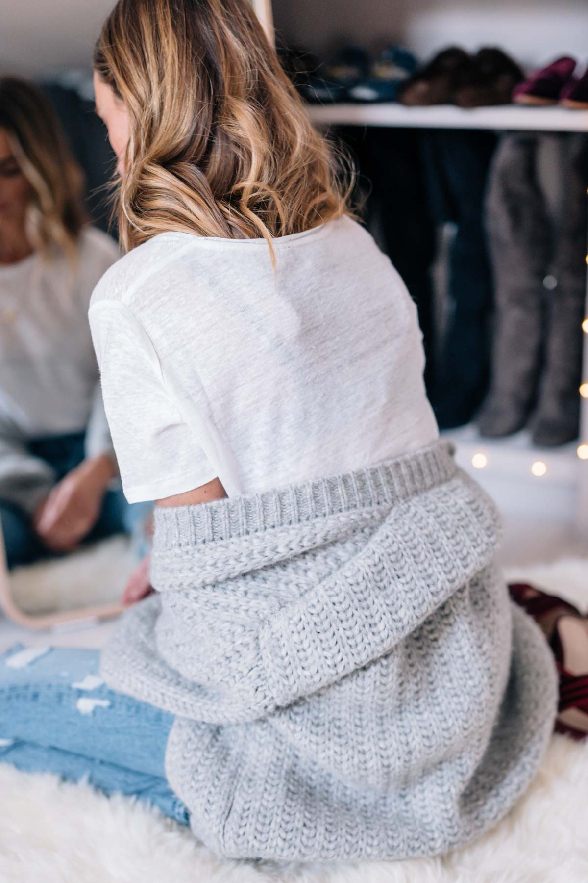Jess Ann Kirby gets comfortable at home with a chunky knit sweater and white tee