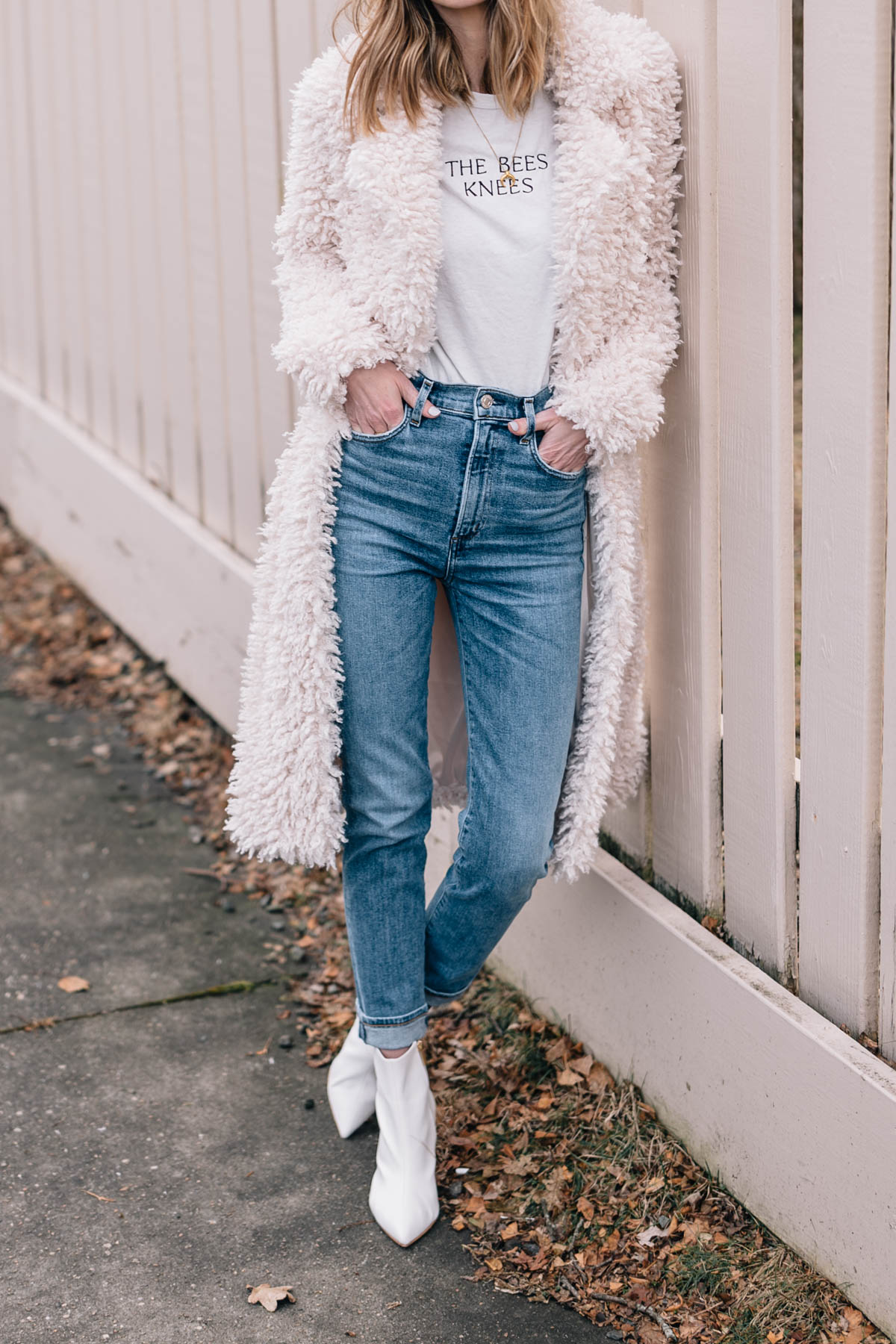 Jess Ann Kirby styles Agolde skinny jeans with white booties and a faux fur jacket