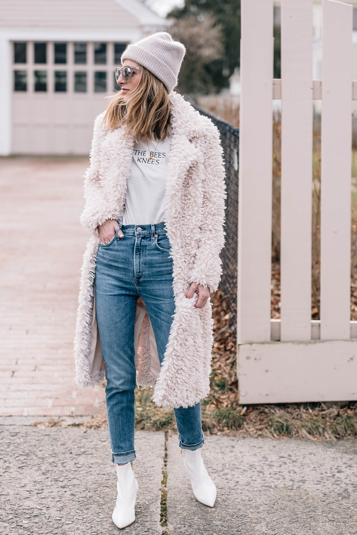 Jess Ann Kirby pairs a faux fur coat with skinny jeans and white ankle boots