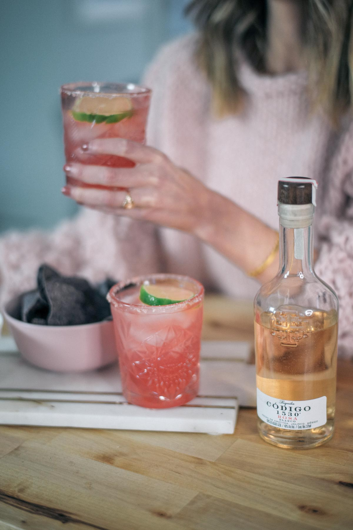 Jess Ann Kirby sips a komucha margarita in celebration of National Margarita Day
