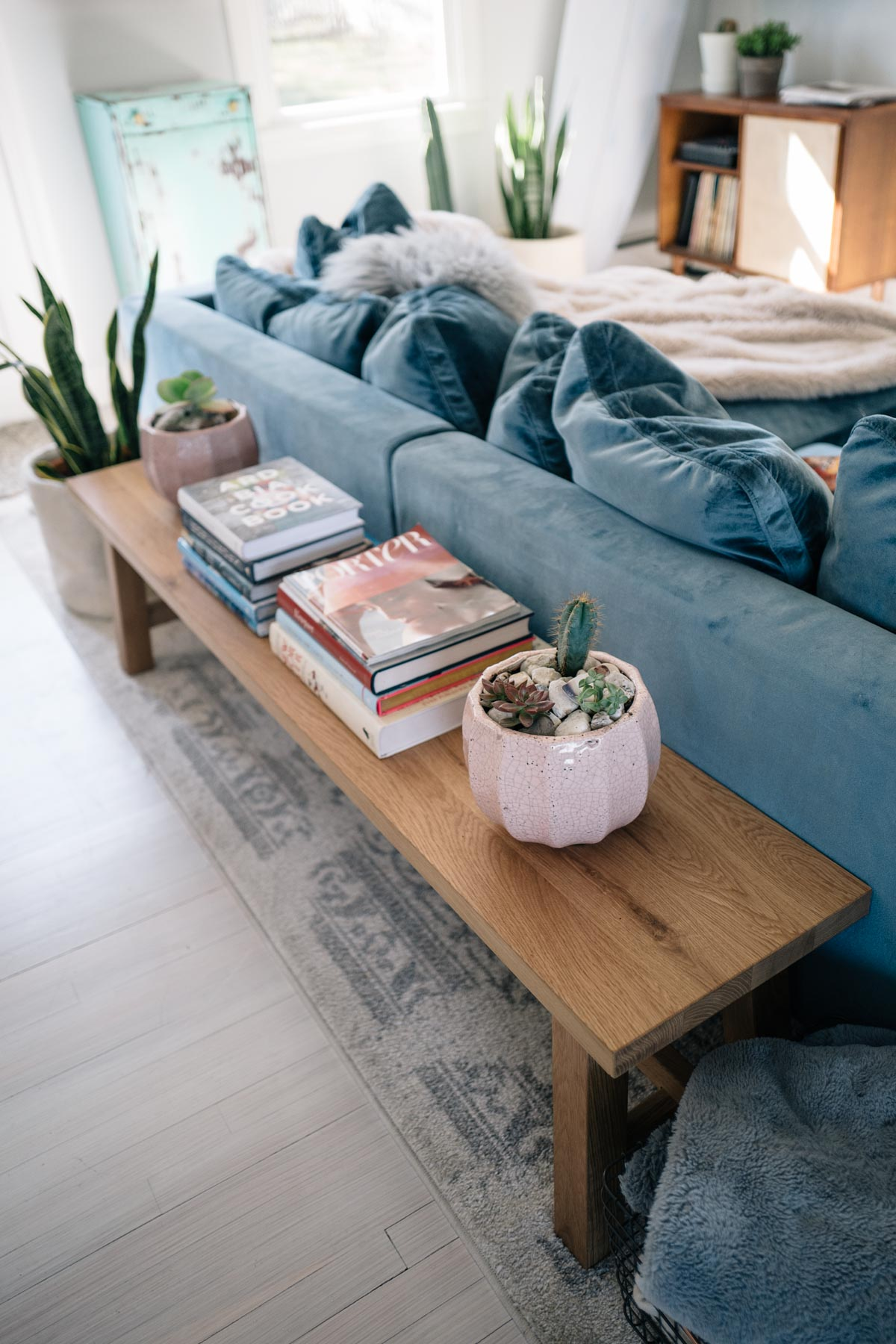 Jess Ann Kirby styles her living room with stylish pieces like a terracotta pot from Anthropologie