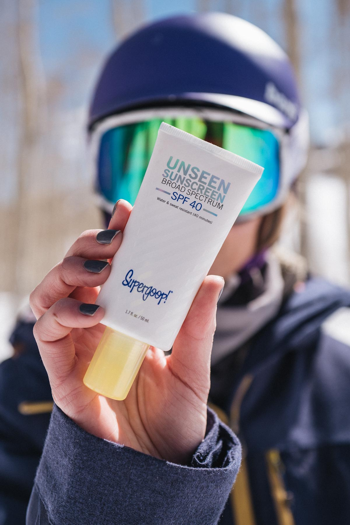Jess Ann Kirby relies on Supergoop Unseen Sunscreen for protection from the sun while snowboarding