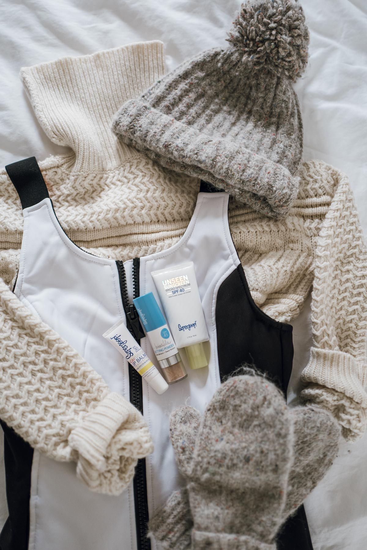 Jess Ann Kirby packs for a trip to Beaver Creek with the essentials including Supergoop! products and the Topshopo Sno snowsuit
