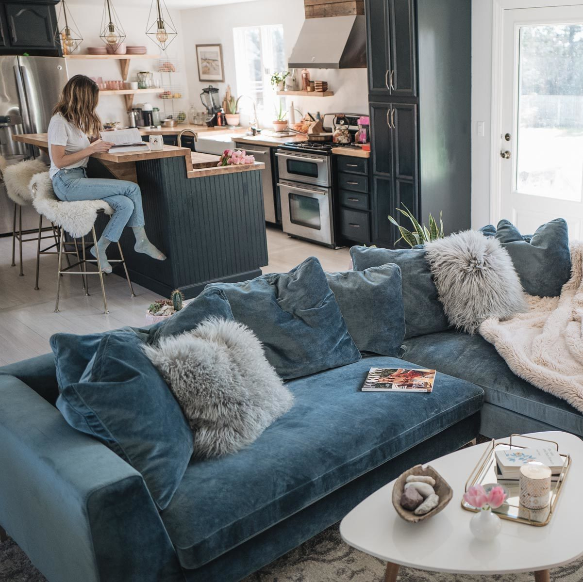 Jess Ann Kirby reveals her living room renovation featuring a velvet sectional sofa