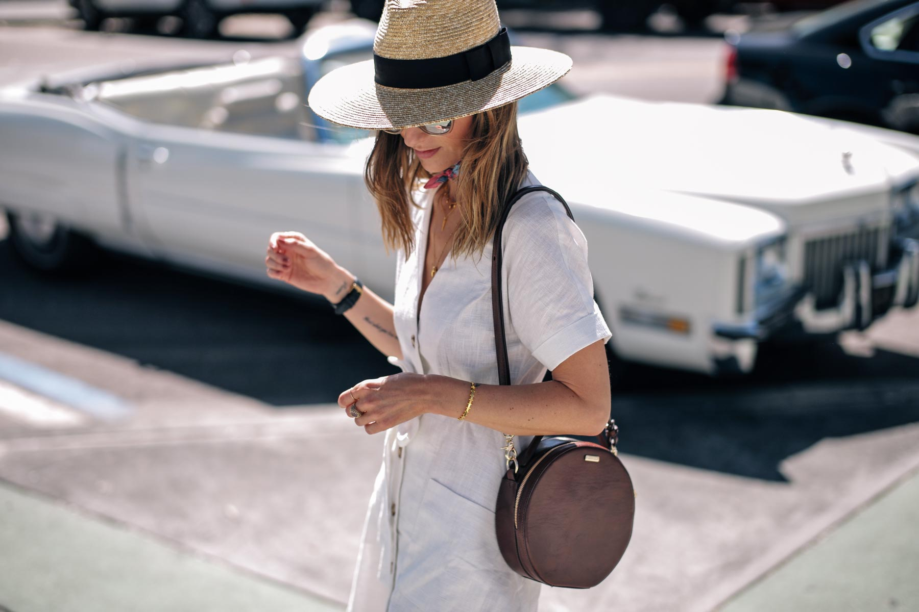 Jess Ann Kirby wears a Moon River Linen Dress and Brahmin Lane Crossbody bag in Saint Petersburg, Florida