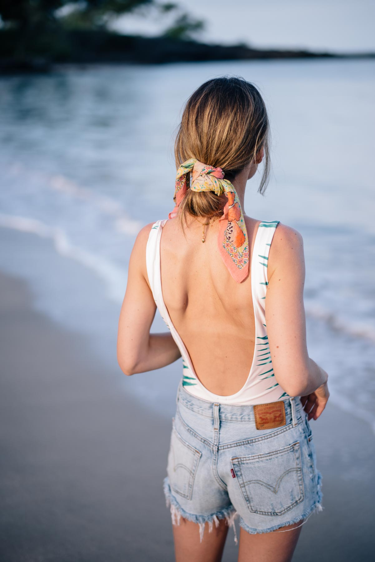 Jess Ann Kirby throws on a one piece bathing suit from Aerie and Levis with a silk hair tie for a day at the beach