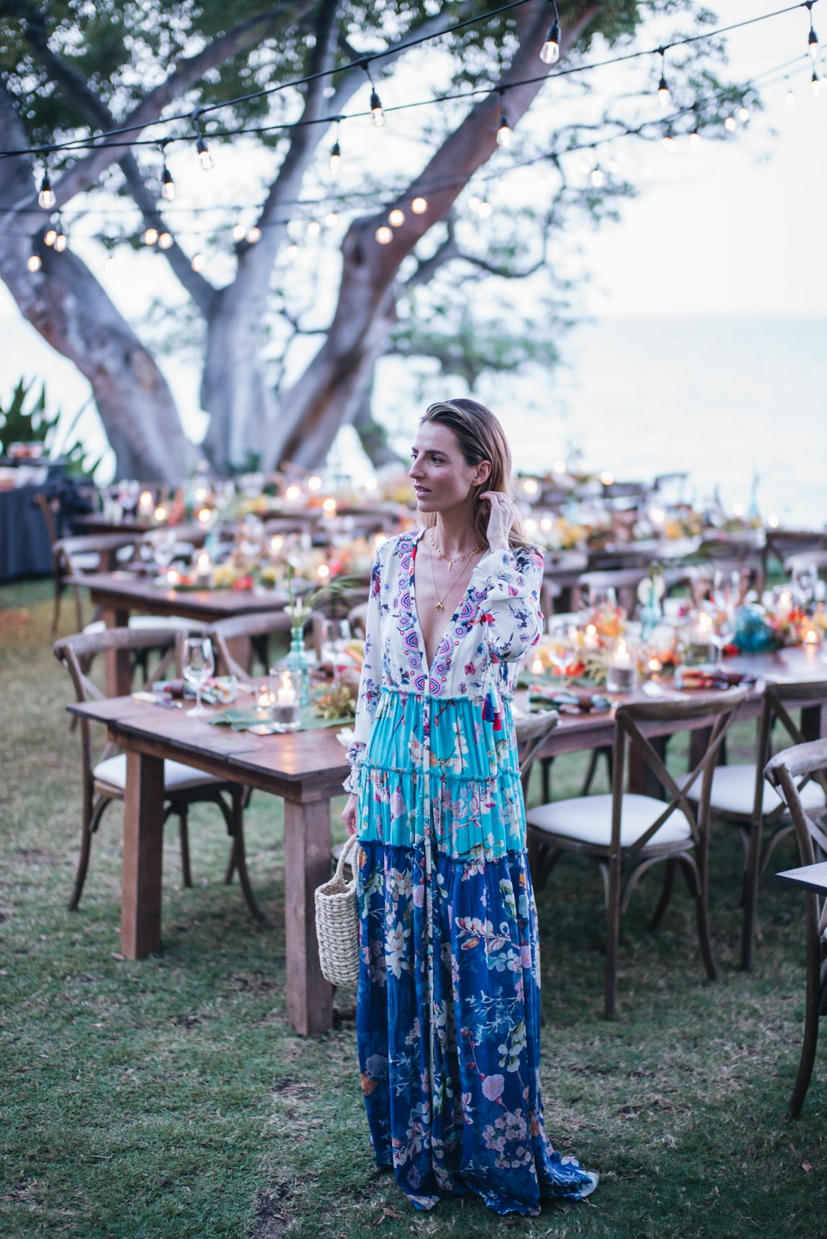 Jess Ann Kirby attends a tropic wedding in a Rococo Sand Maxi Dress