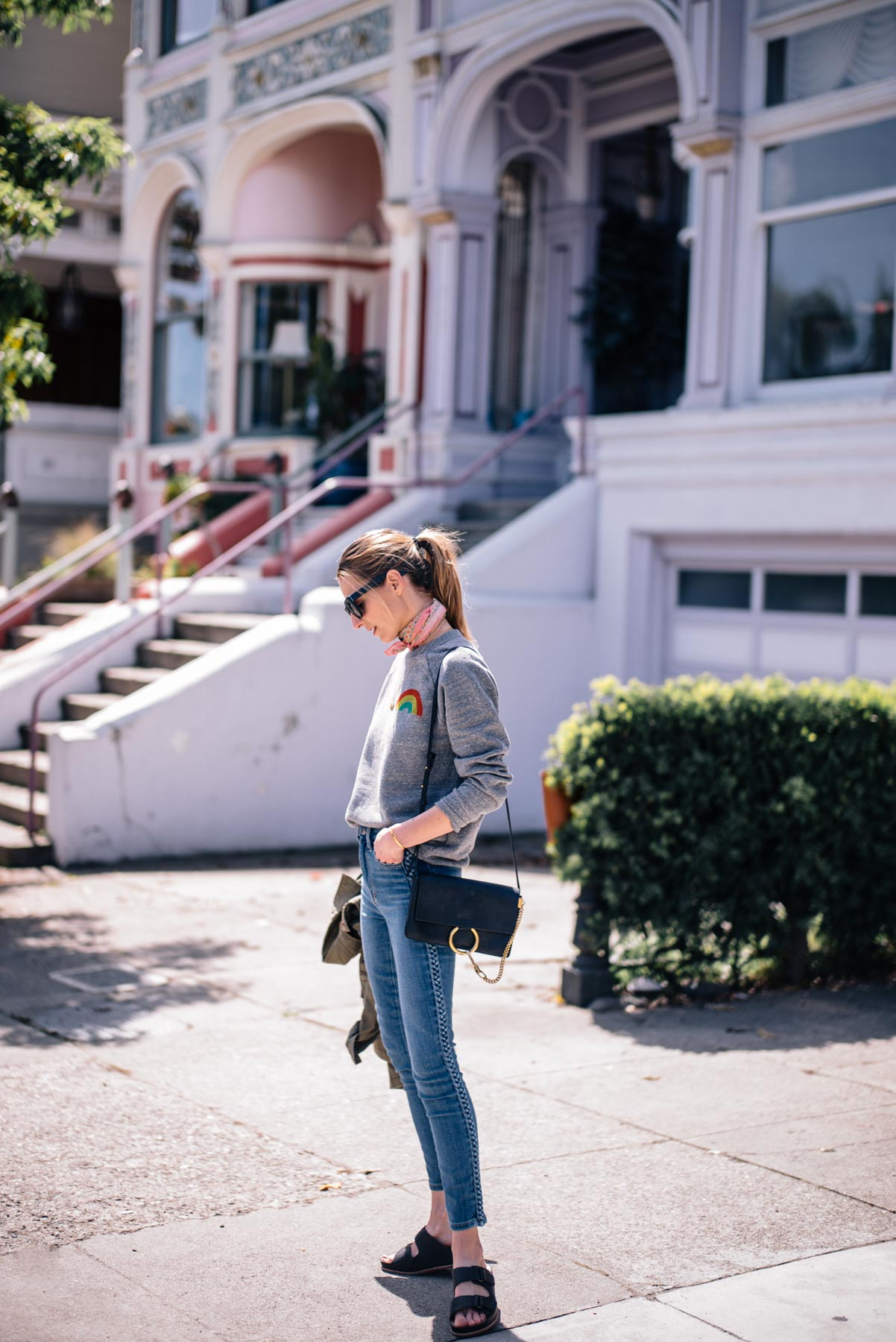 Jess Ann Kirby wears a Chloe bag, Joes Jeans and Kork-Ease sandals in San Francisco