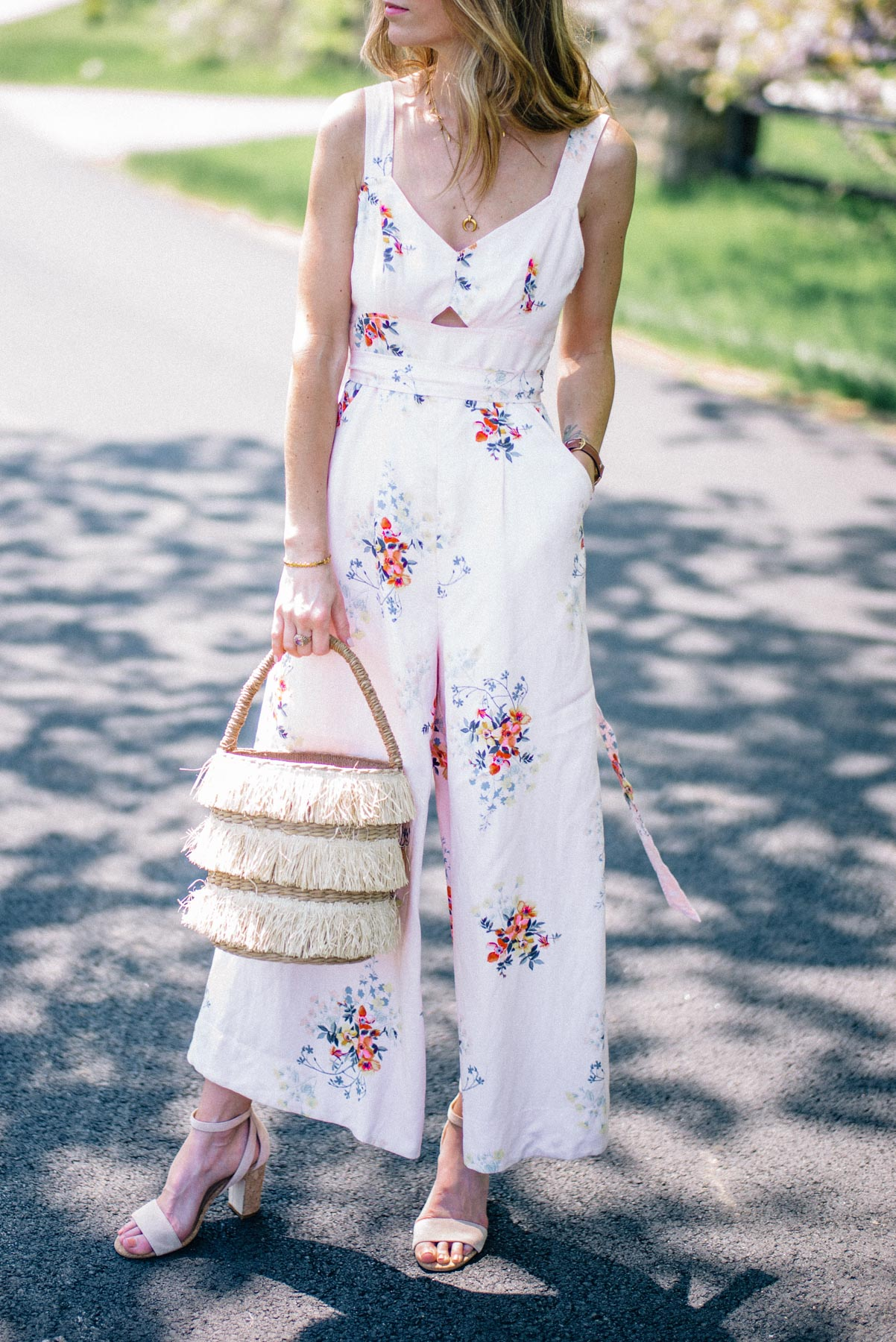 Jess Ann Kirby shares her favorite summer wedding outfit ideas including jumpsuits and statement accessories