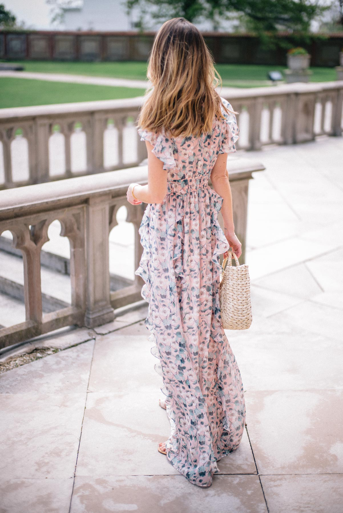 Jess Ann Kirby relies on a maxi dress for a foolproof summer wedding outfit