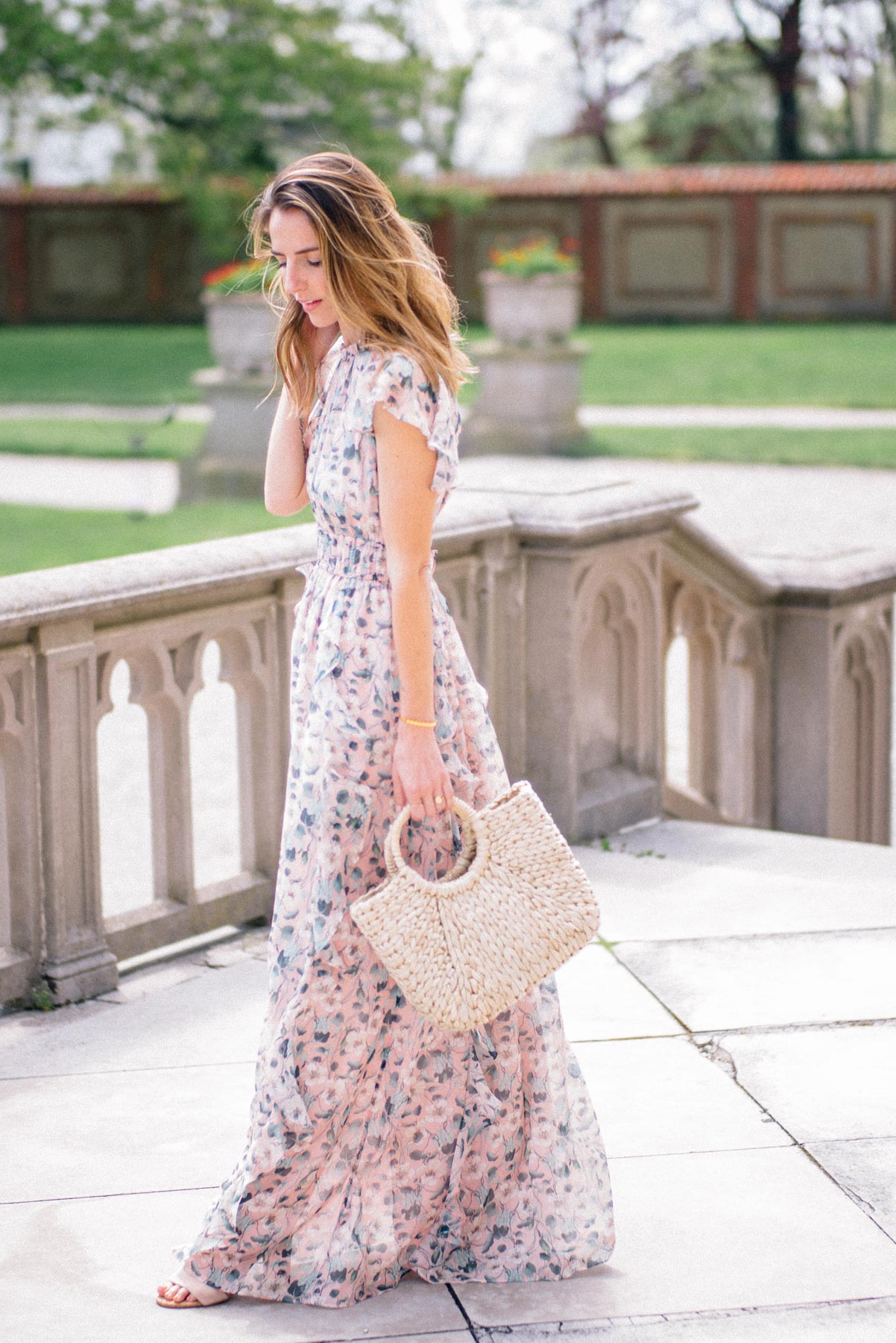 Jess Ann Kirby wears a Shoshanna printed maxi dress for a go-to summer wedding look