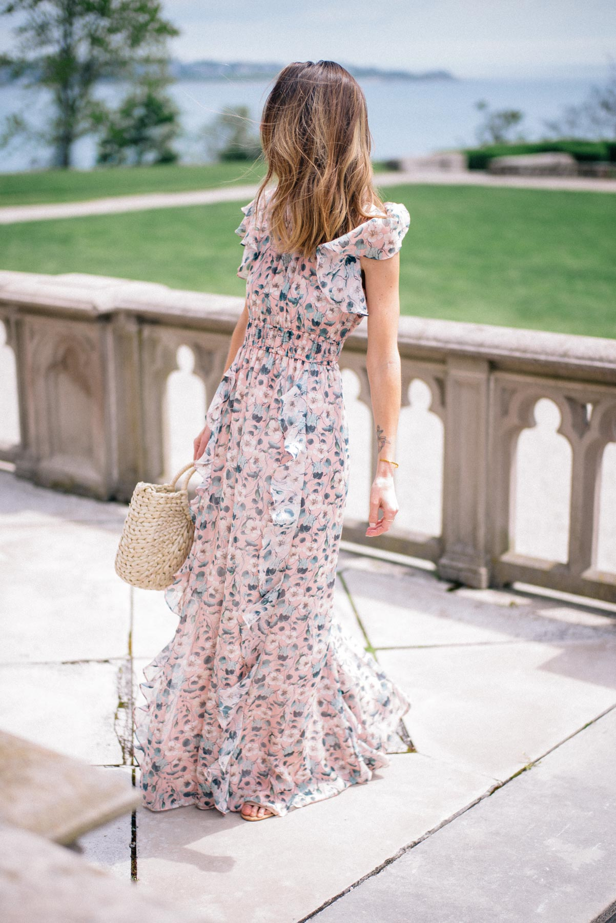 Jess Ann Kirby shares her summer wedding style including printed maxi dresses and straw accessories