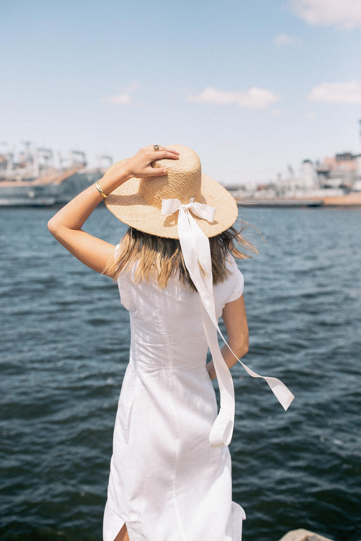 Jess Ann Kirby spends 48 hours in Philadelphia in a straw hat and white dress from Anthropologie.