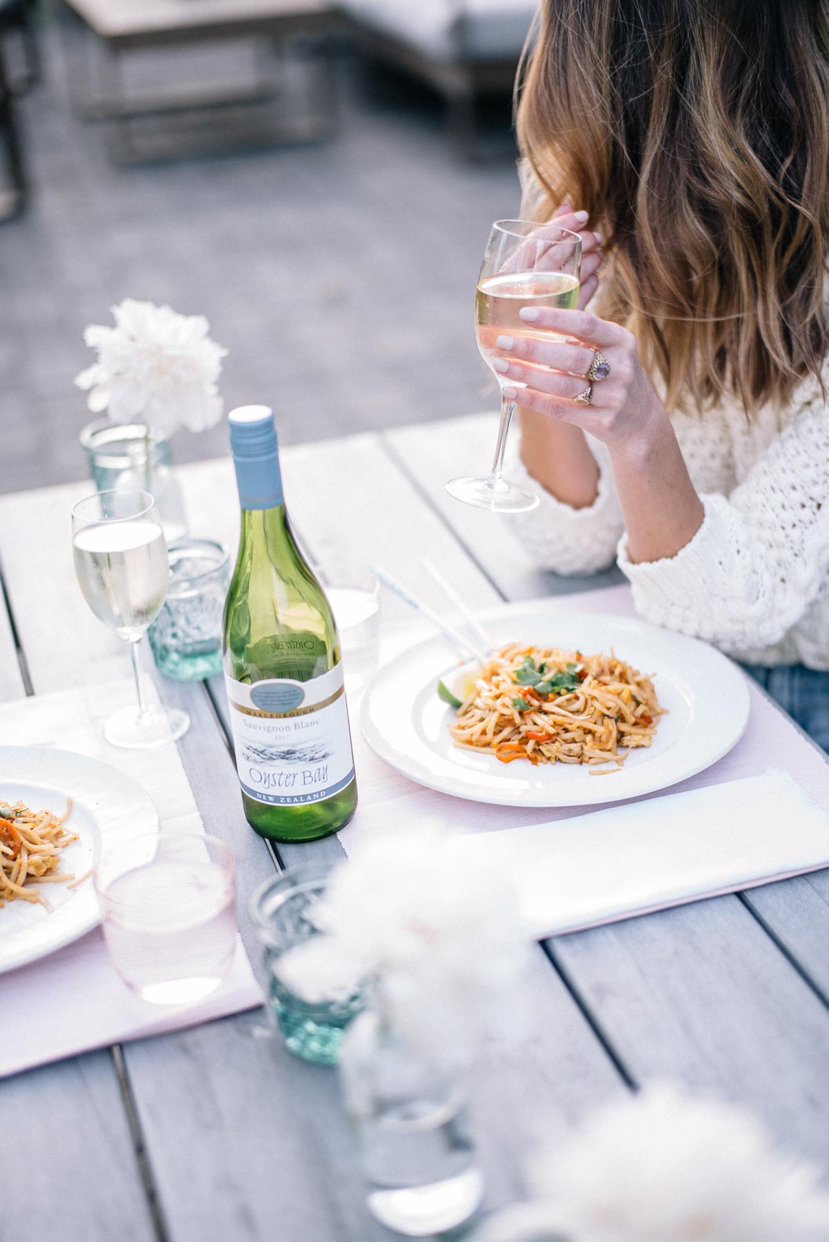 Jess Ann Kirby sips on Oyster Bay wine during an at-home date night