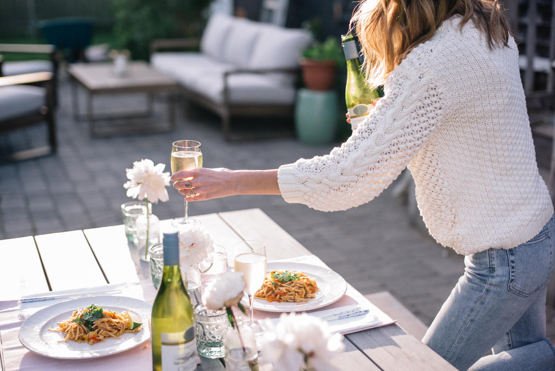 Jess Ann Kirby enjoys her outdoor patio with an at-home date night and Oyster Bay sauvignon blanc