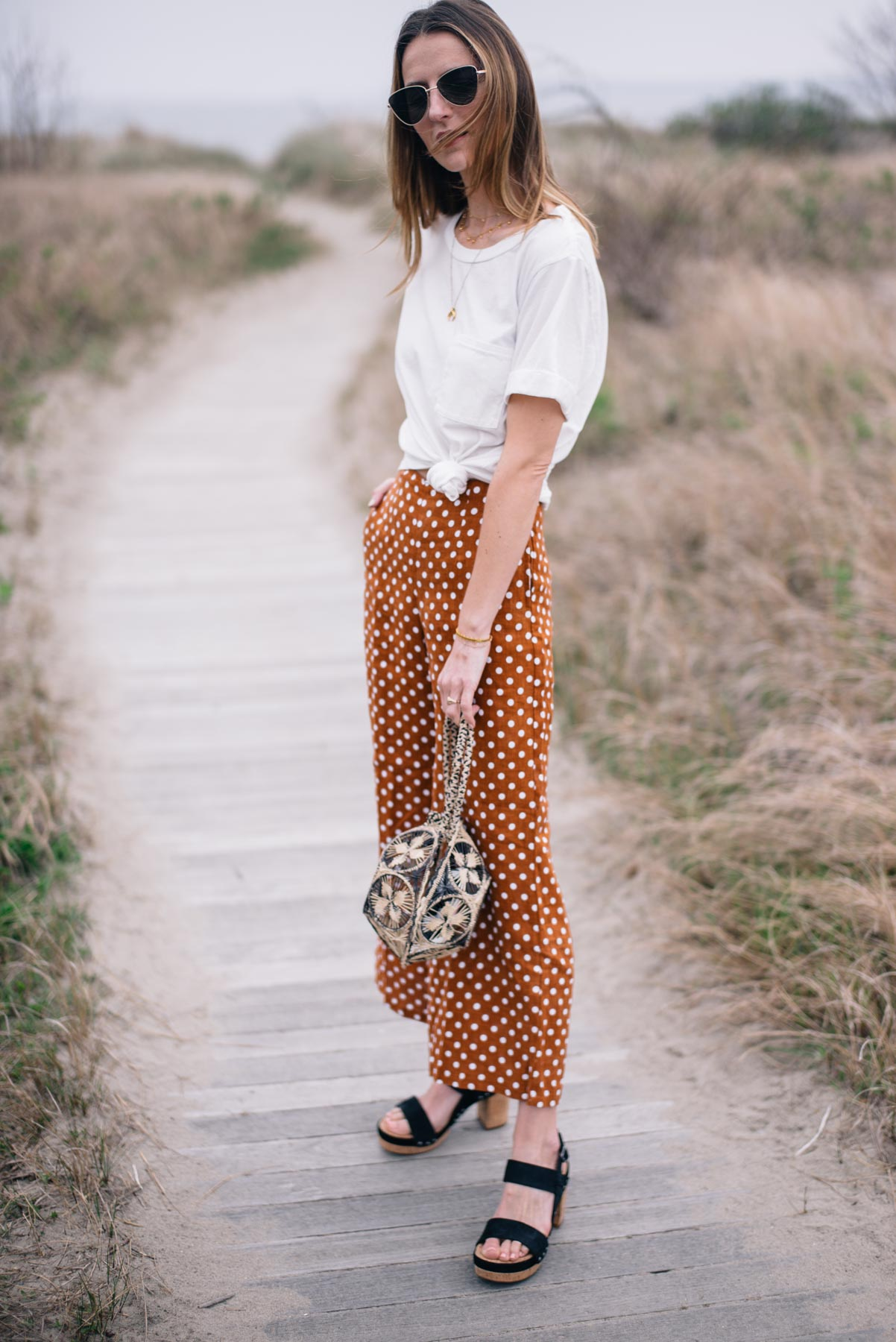 Jess Ann Kirby styles Faithfull wide leg polka dot pants from Anthropologie for a casual spring look