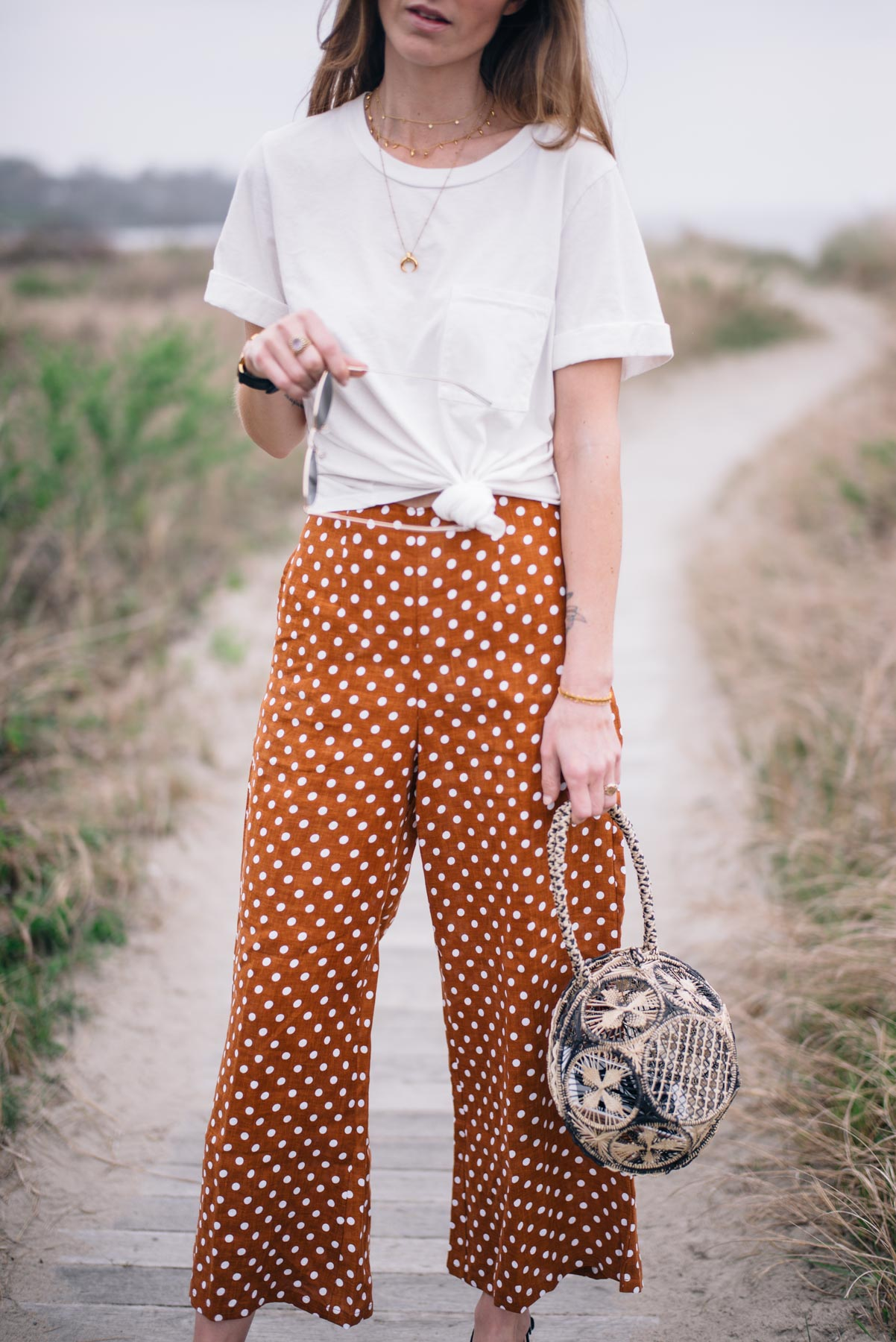 Jess Ann Kirby styles a boyfriend tee with Faithfull wide leg polka dot pants from Anthropologie