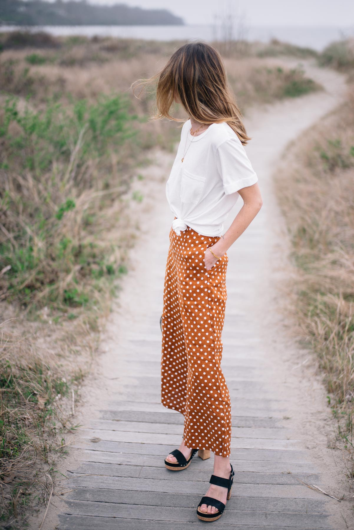 Jess Ann Kirby styles a spring look with statement wide leg pants and a simple tee from Anthropologie