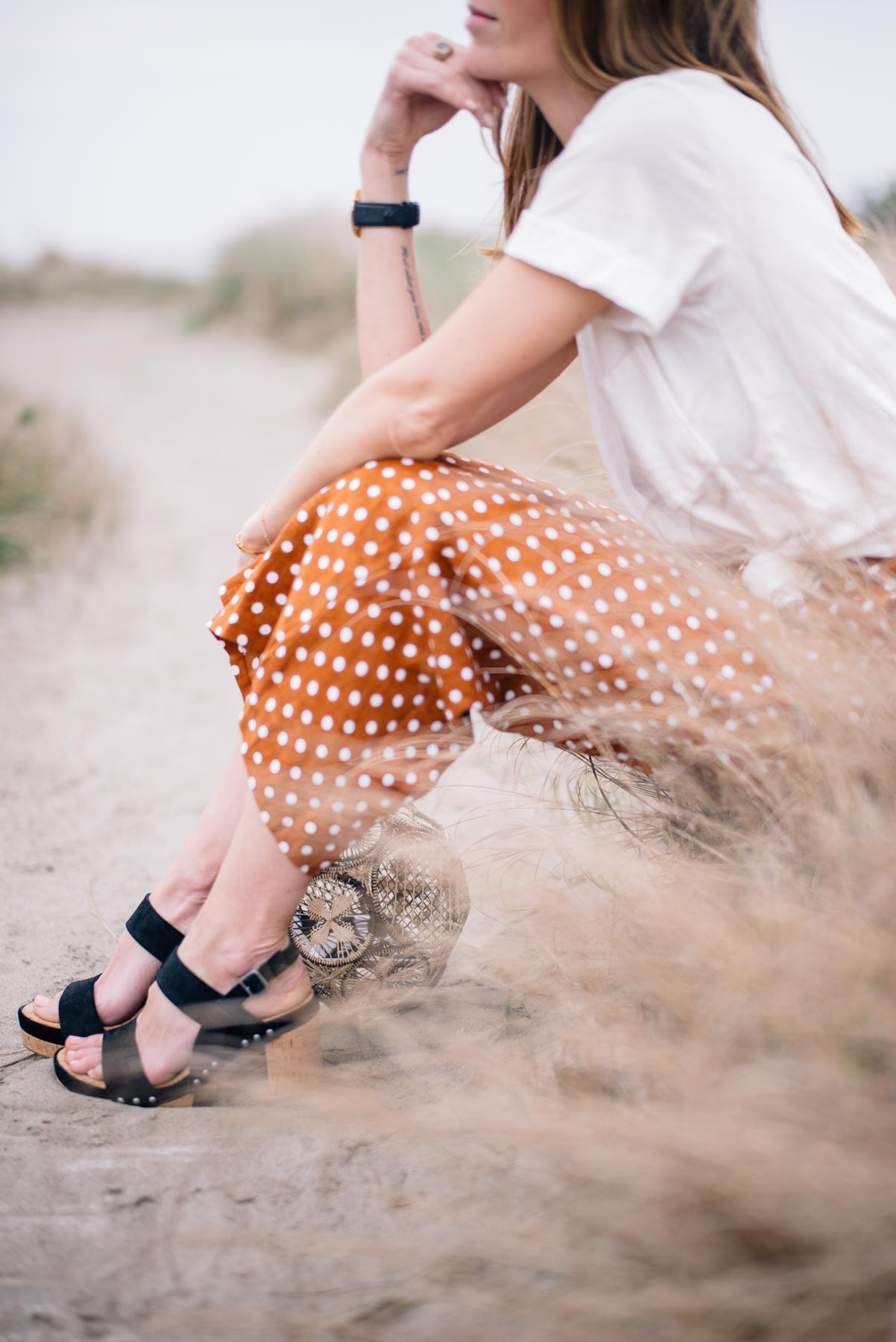 Jess Ann Kirby pairs wide leg polka dot pants with a boyfriend tee and block heels