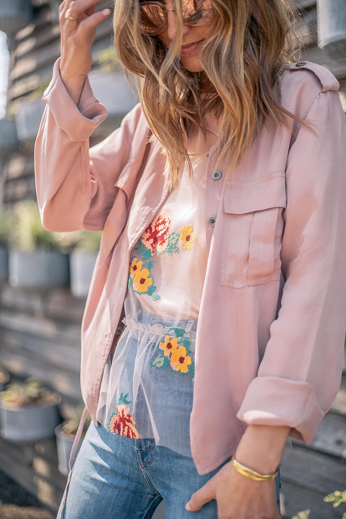 Jess Ann Kirby styles a spring look with the Rails anorak and Eva Franco Rhapsody floral top from Anthropologie
