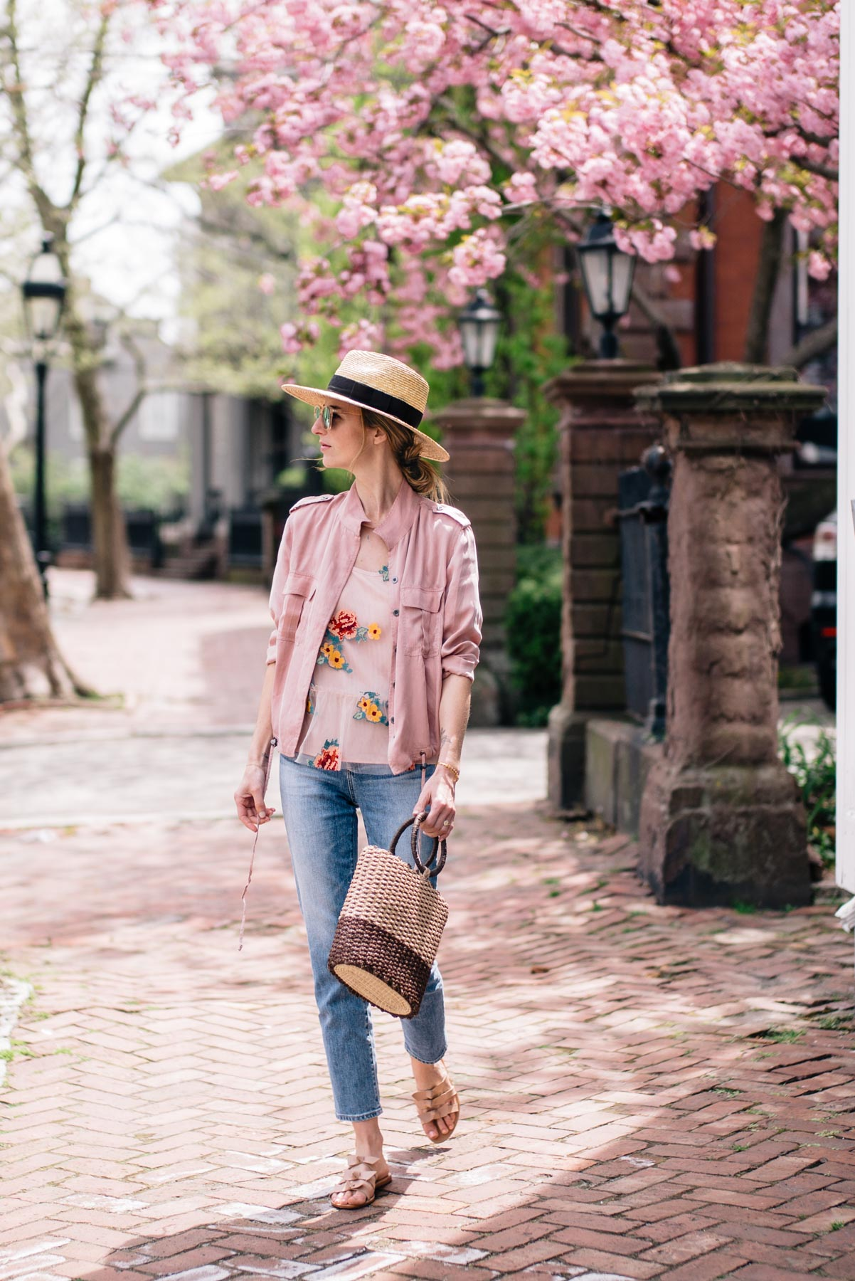 Jess Ann Kirby styles a spring look with straw accessories and high rise jeans in College Hill, Providence
