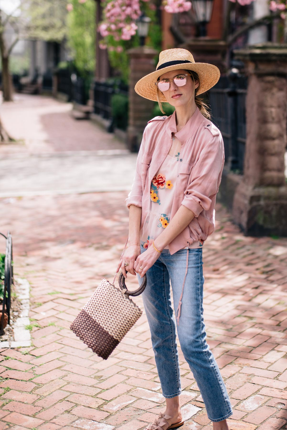 Jess Ann Kirby wears Rails Rowen Anorak Straw Bag and AG Pheobe High Rise jeans in Providence, Rhode Island
