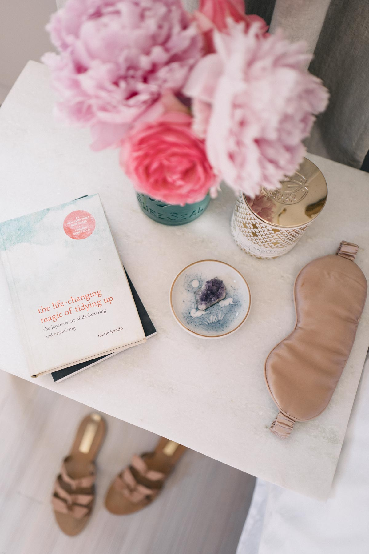 Jess Ann Kirby keeps fresh flowers and a silk sleep mask on her Target bedside table