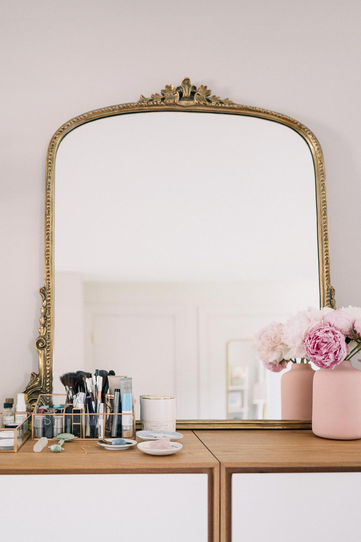 Jess Ann Kirby styles the gleaming primrose mirror from Anthropologie on top of Rove Concepts vanities