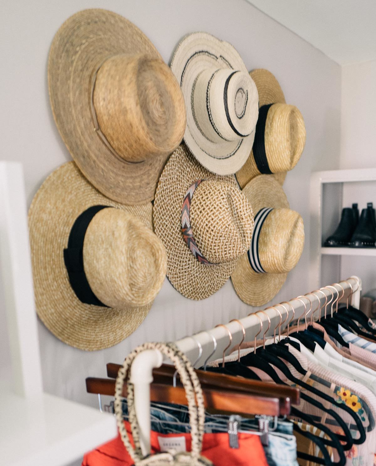 Jess Ann Kirby utilizes wall space by hanging her hats above a clothing rack